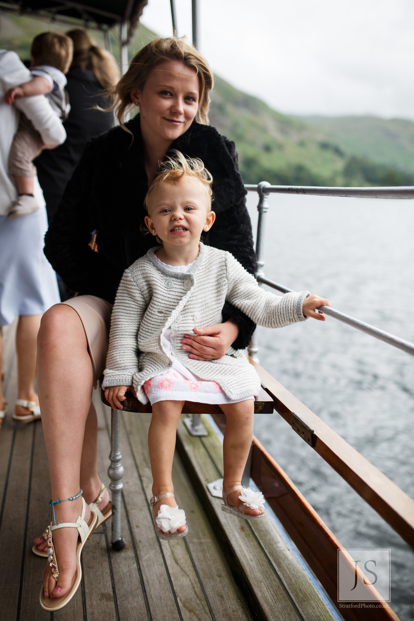 A young mother and child enjoy Lake Ullswater from a boat.jpg
