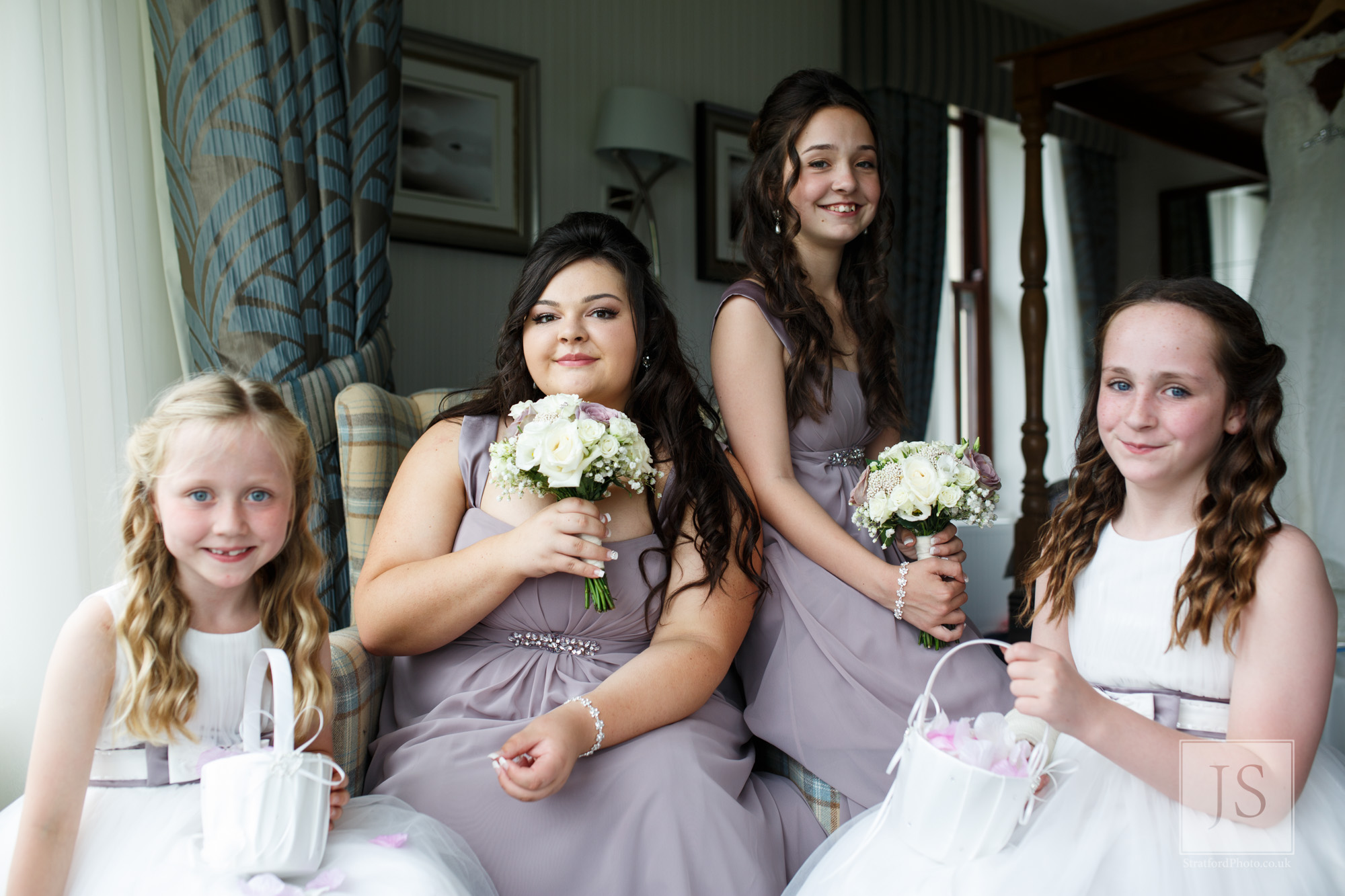 Two bridesmaids and flower girls pose for a photo.jpg