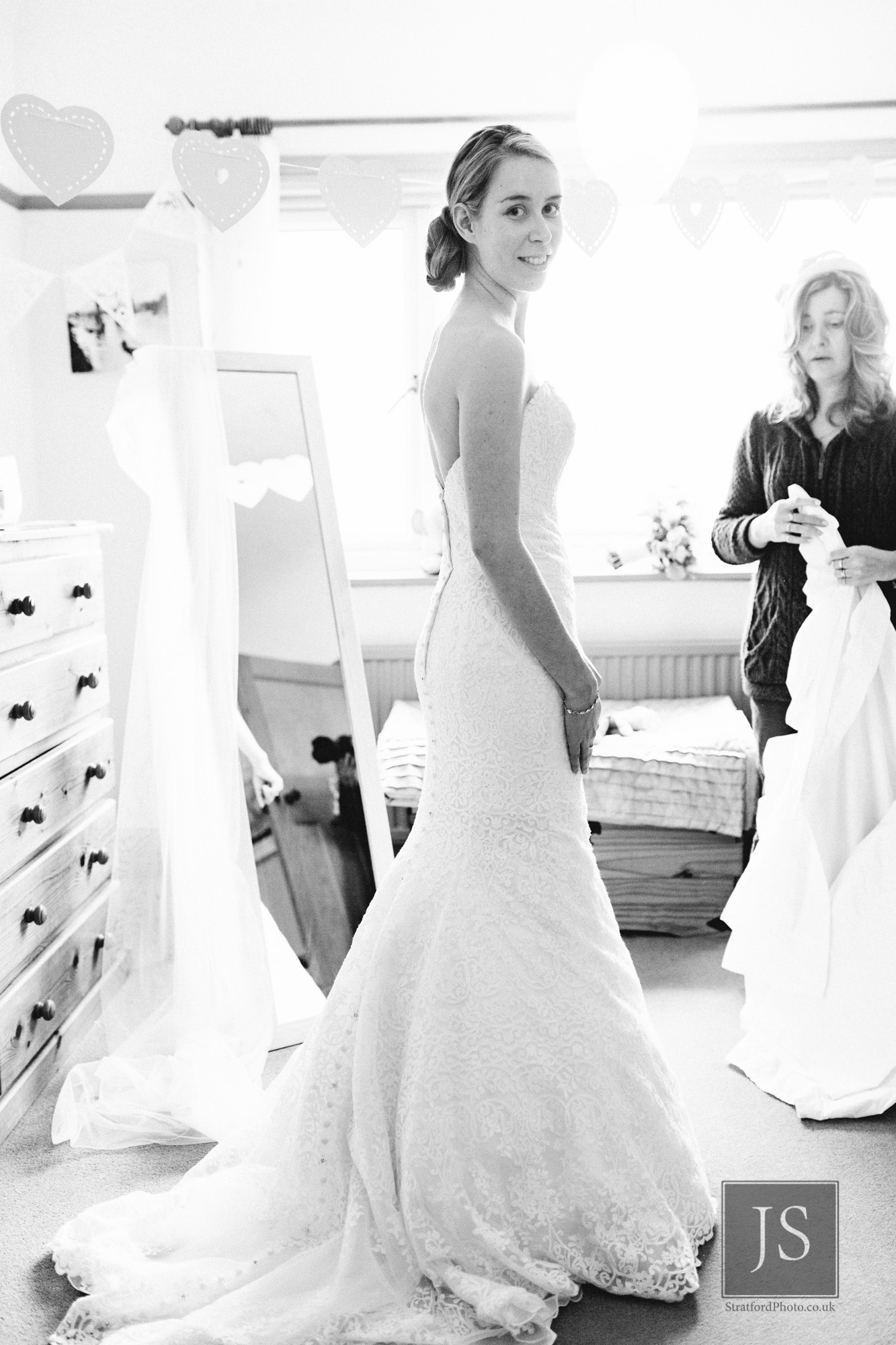 A bride poses in her wedding dress in the morning.jpg