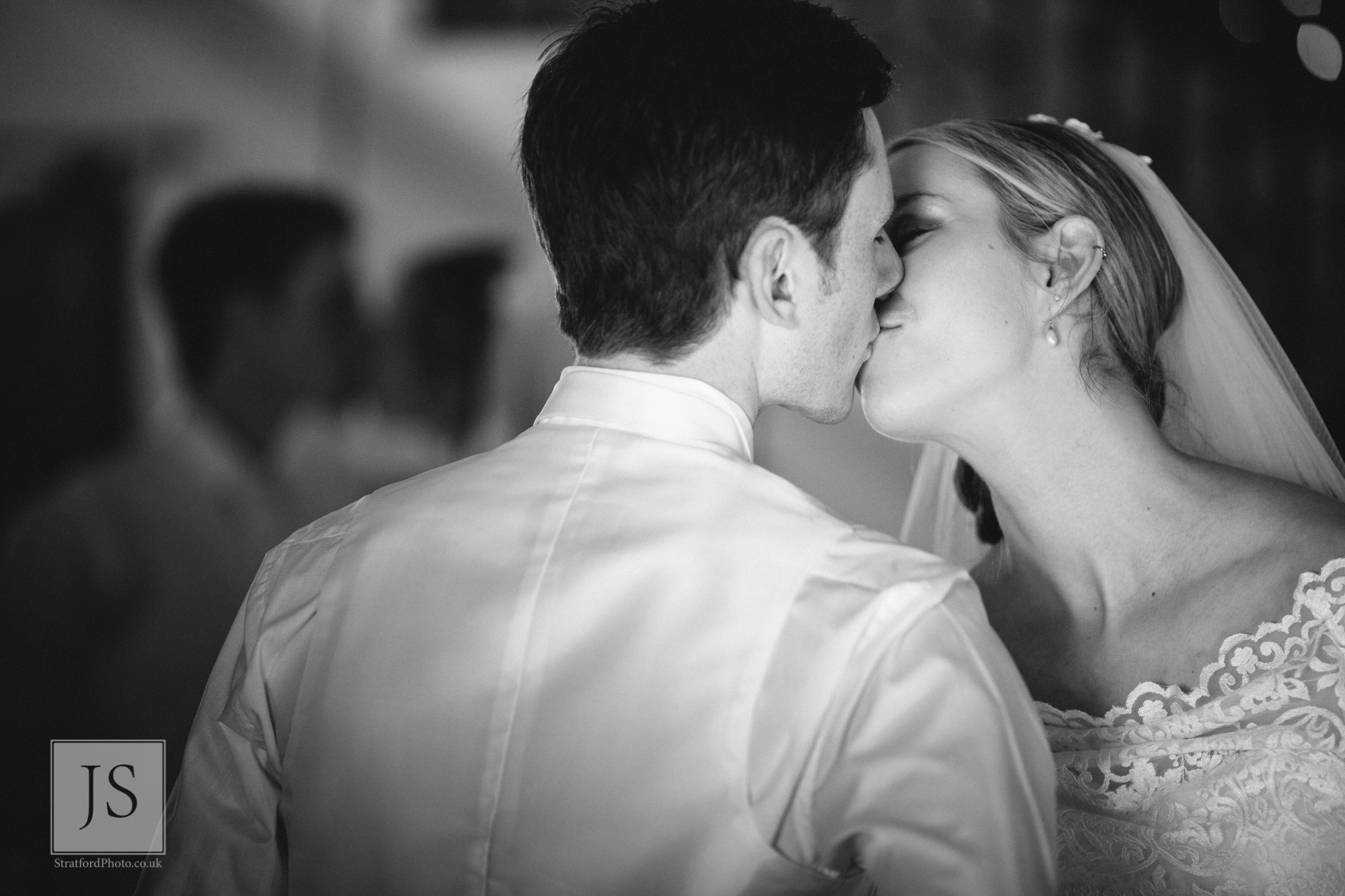 A bride and groom share a romantic kiss.jpg