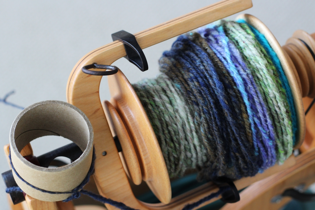 Mugs, cups, and cardboard tubes make it so easy to take a break when you're in the middle of chain-plying handspun. | My Favorite Chain-Plying Trick - withwool.com