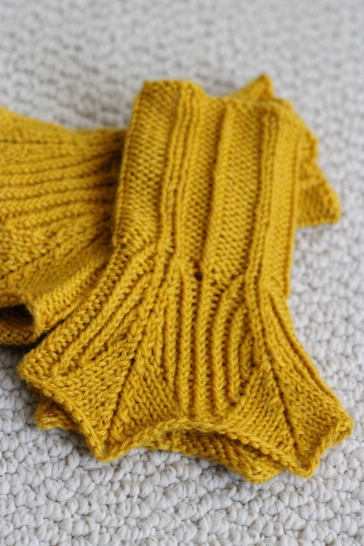 The kind of yarn you use matters! I used 2 different yarns to make 2 pairs of Precipitous cuffs on the same needles, and got two wildly different finished projects. -  FO: Precipitous Cuffs     withwool.com