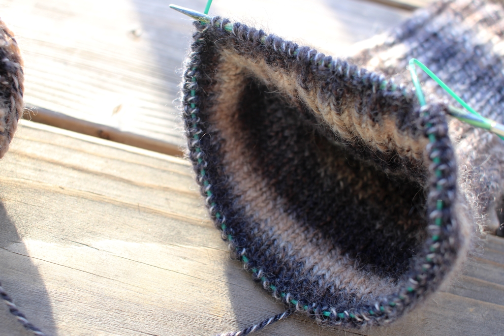 I'm knitting my first pair of handspun socks. It was a nervous cast on, but the first sock is going really well even though I ripped out the gusset. Knitting A Handspun Sock | withwool.com