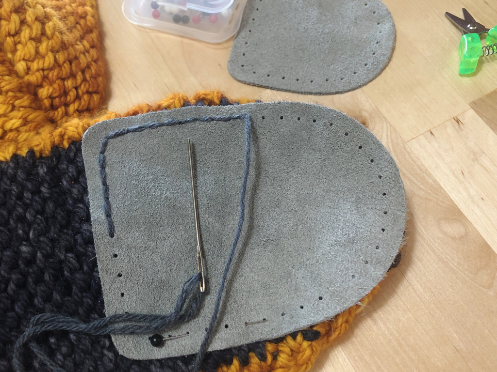 Learn how to sew soles onto your slippers for extra grip and added durability. #knitting | withwool.com