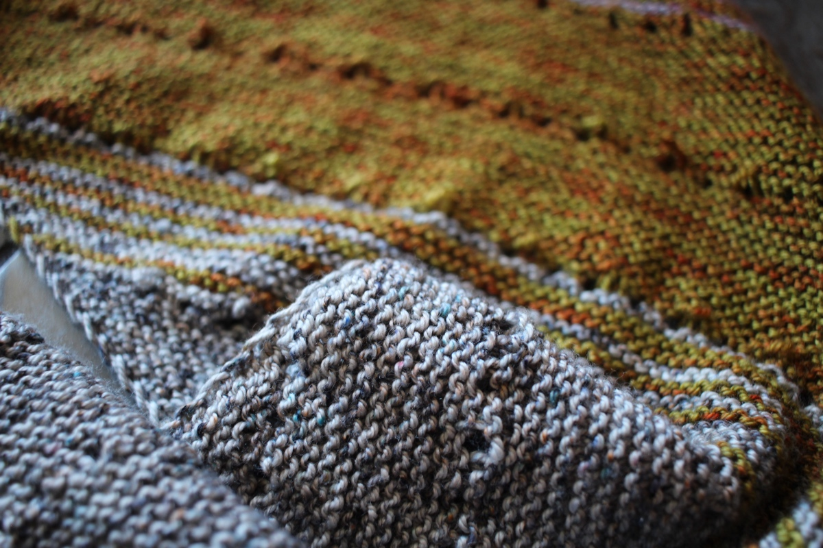 A close up view of my in progress Free Your Fade shawl with grey and green stripes.  Marginalia and Spreadsheets || withwool.com