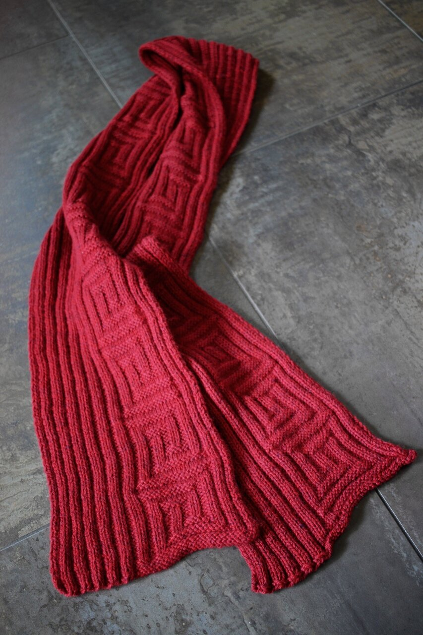 A ribbed red scarf for the Foster Care to Success Red Scarf Project. || withwool.com