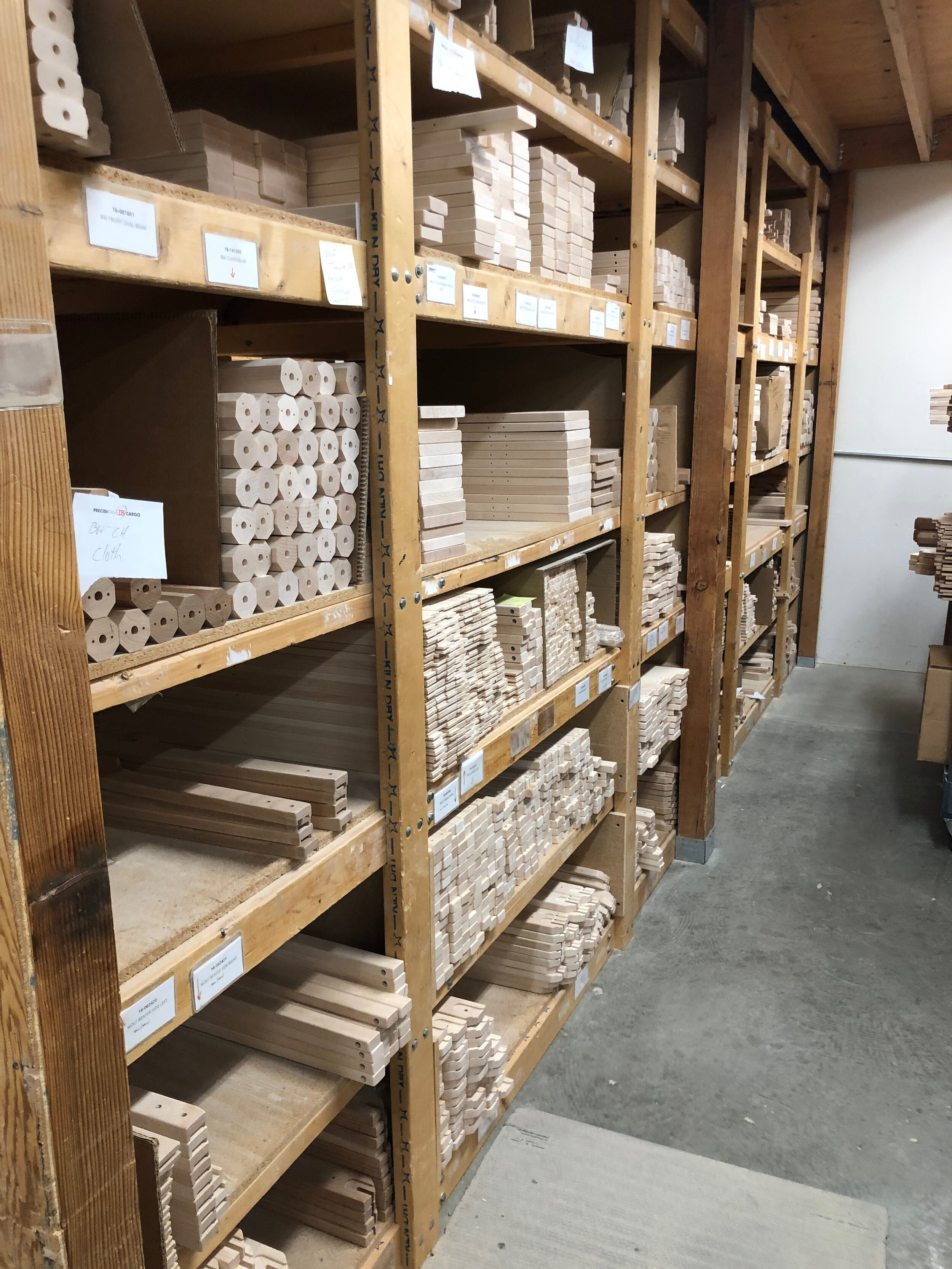Shelves in a storeroom for un-assembled parts.  Celebrating Schacht's 50th Anniversary || withwool.com  #schacht50years