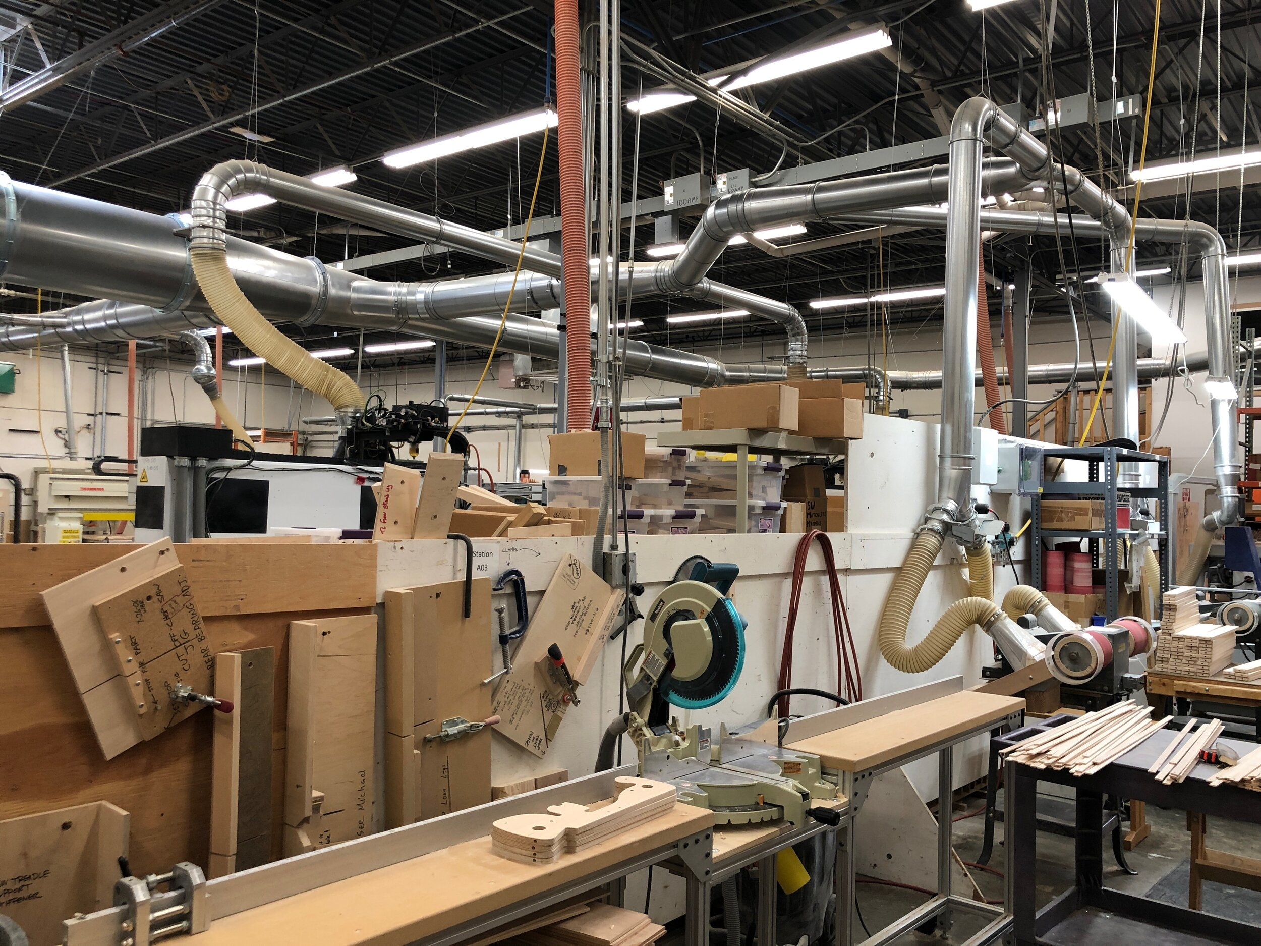A view of the factory showing saws, sanders, and the vacuum ducts.  Celebrating Schacht's 50th Anniversary || withwool.com  #schacht50years