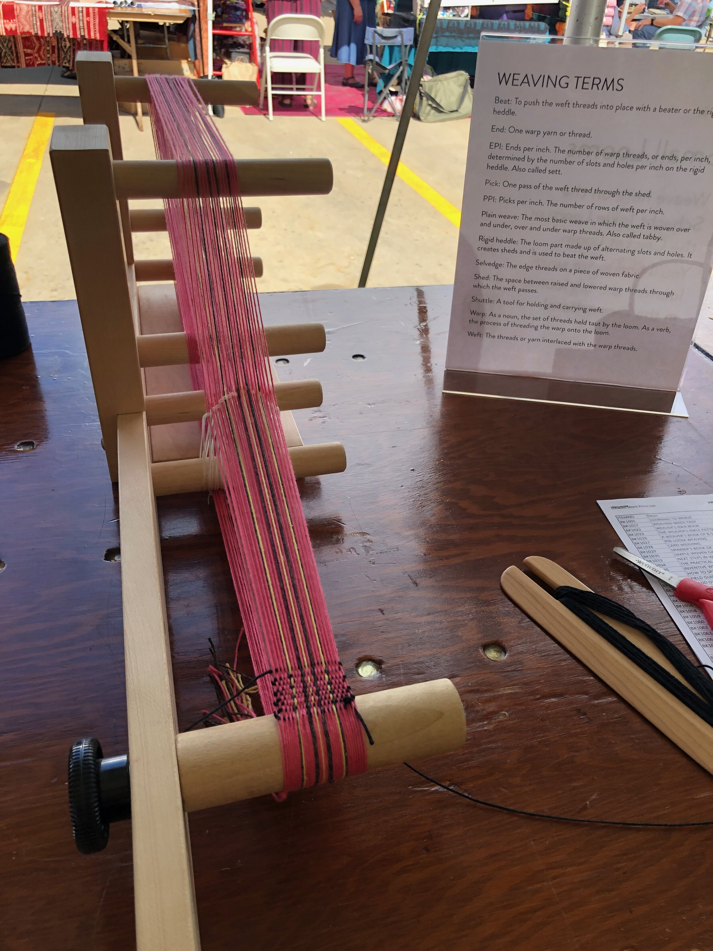 A warped inkle loom set up and ready for weaving with pink, yellow, and black thread.  Celebrating Schacht's 50th Anniversary || withwool.com  #schacht50years
