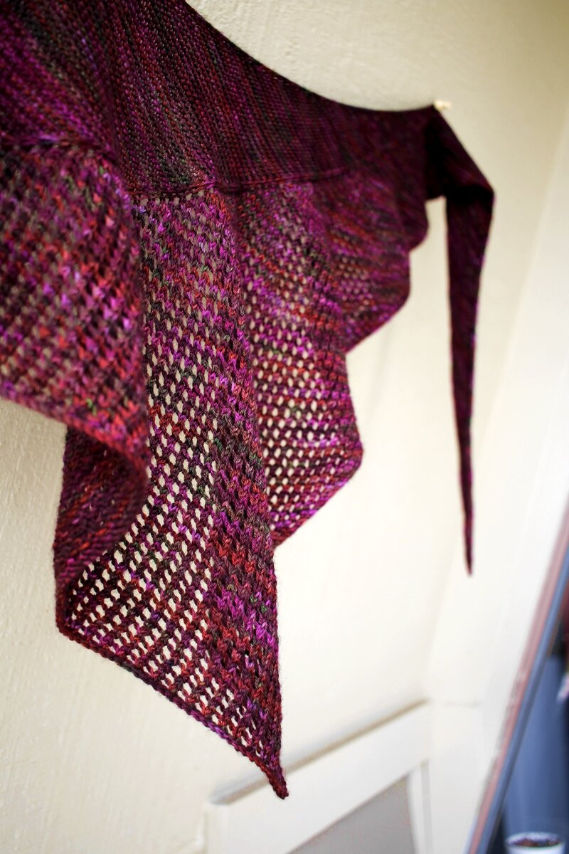 A close up of the mesh section of a Curve of a Boat shawl knit with a variegated magenta yarn. #knitting #finished shawl  Shawl Parade | withwool.com