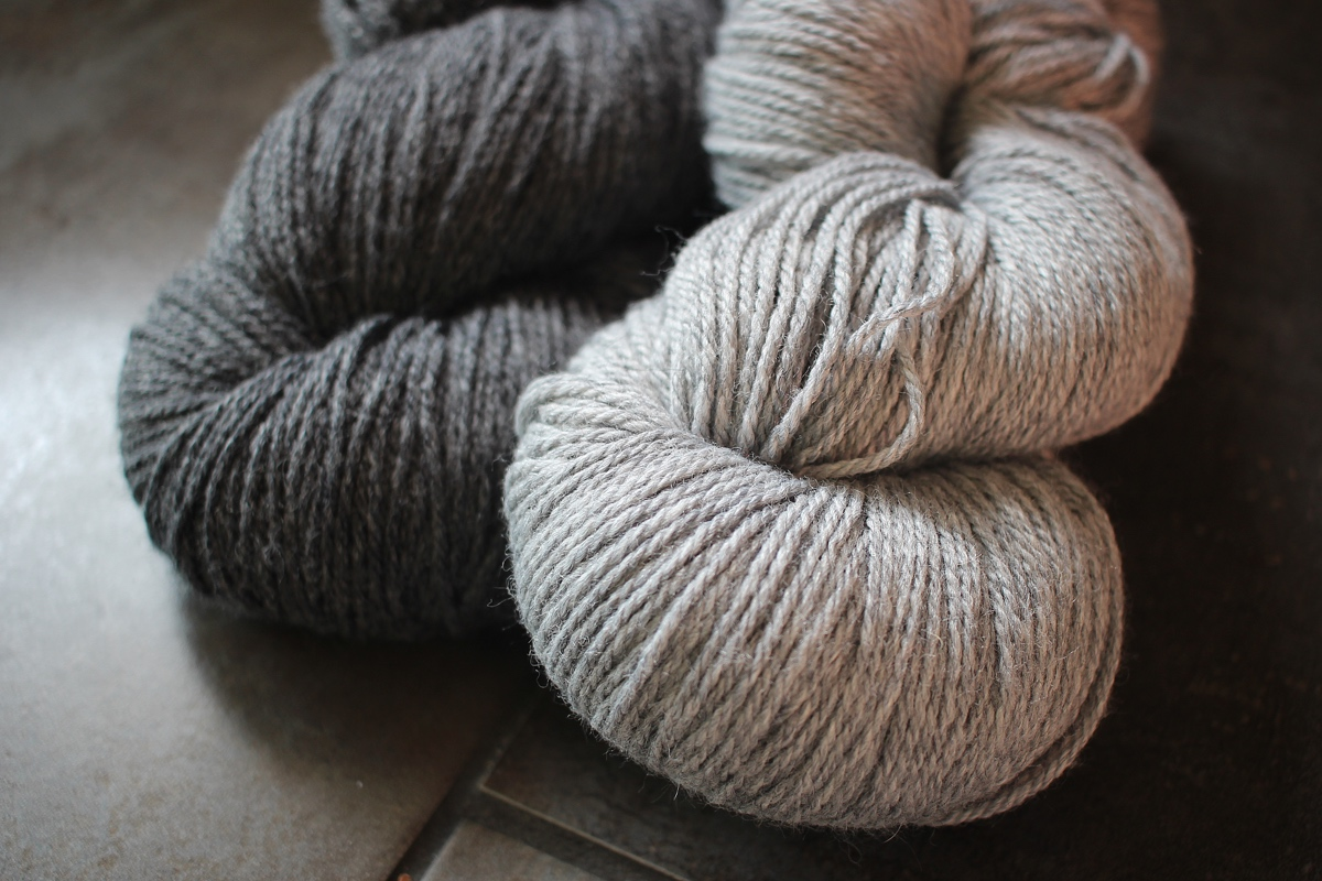 Two skeins of Berroco Vintage DK in Cracked Pepper and Smoke. #knitting  Around Here || withwool.com