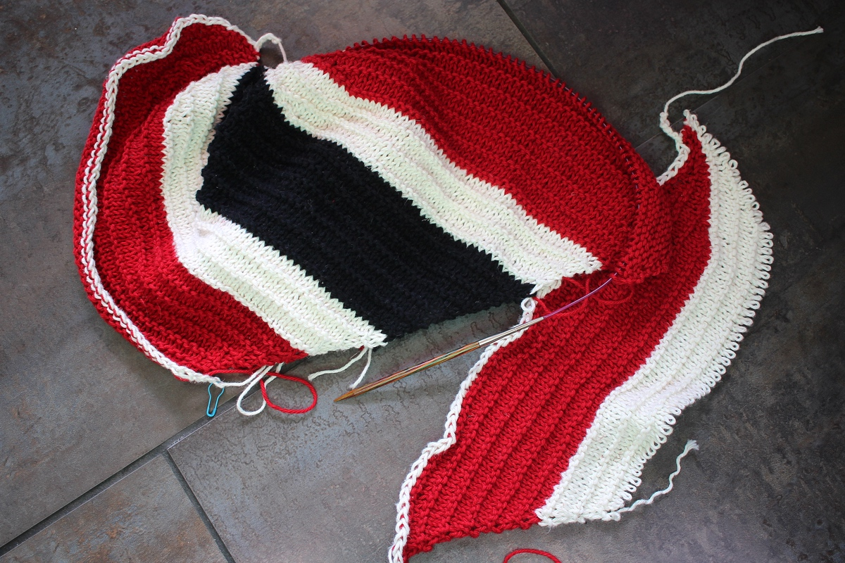 The first and second attempt at making the Cattywampus Hat look like the flag of Trinidad and Tobago. #knitting The second attempt is going much better, and in the right direction.  Around Here || withwool.com