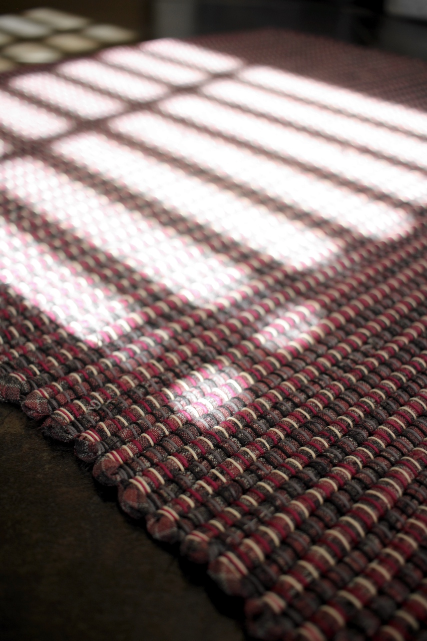 Beams of sunlight falling on a handwoven rag rug.  Around Here || withwool.com