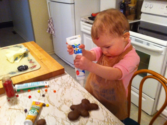 Aryanna working on the frosting..