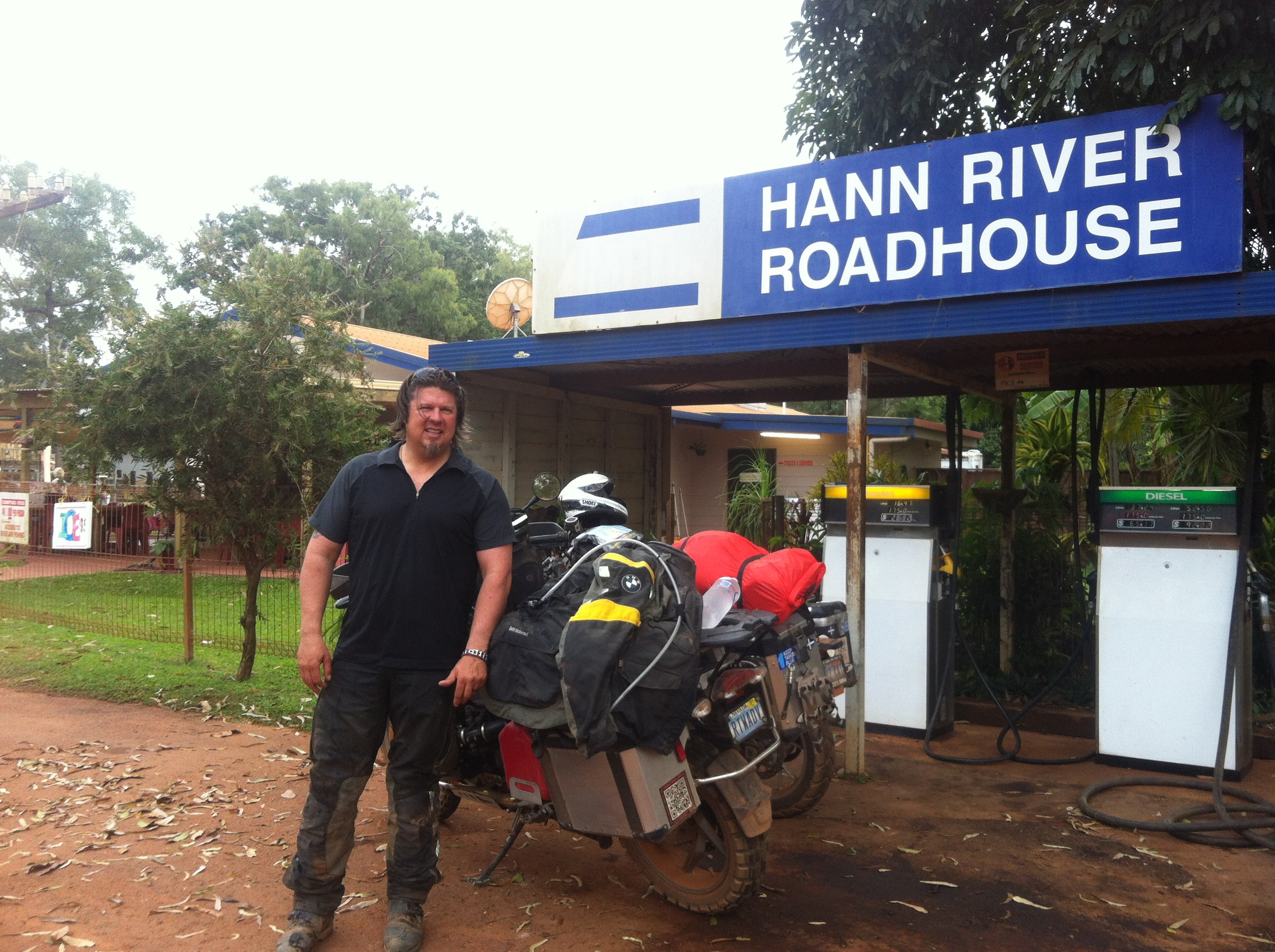 Kevin at the Hann River Roadhouse fuel pumps.