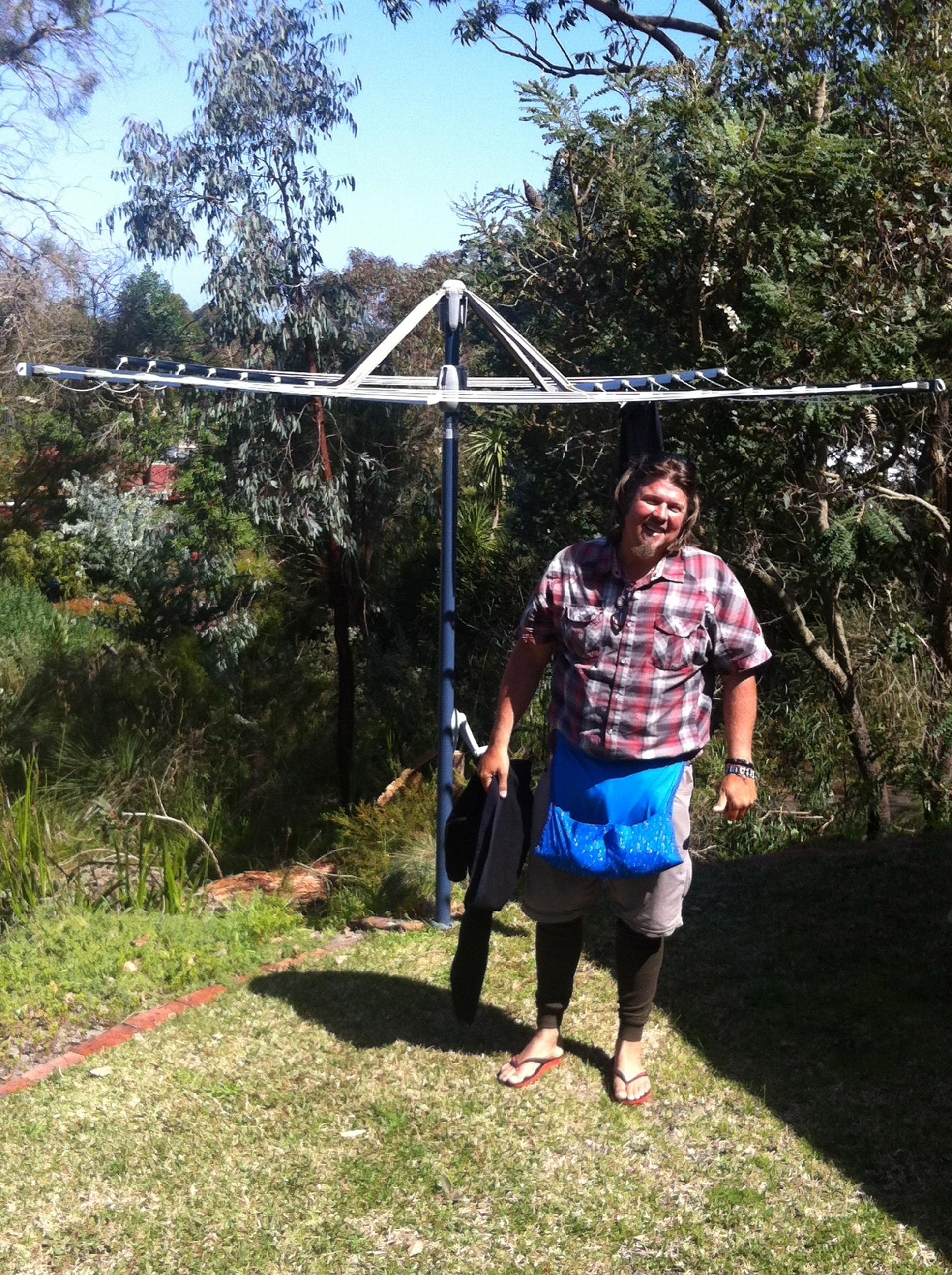 Kev hanging up a quick load of laundry before we hit the cliffs!.....Nice peg holder babe?