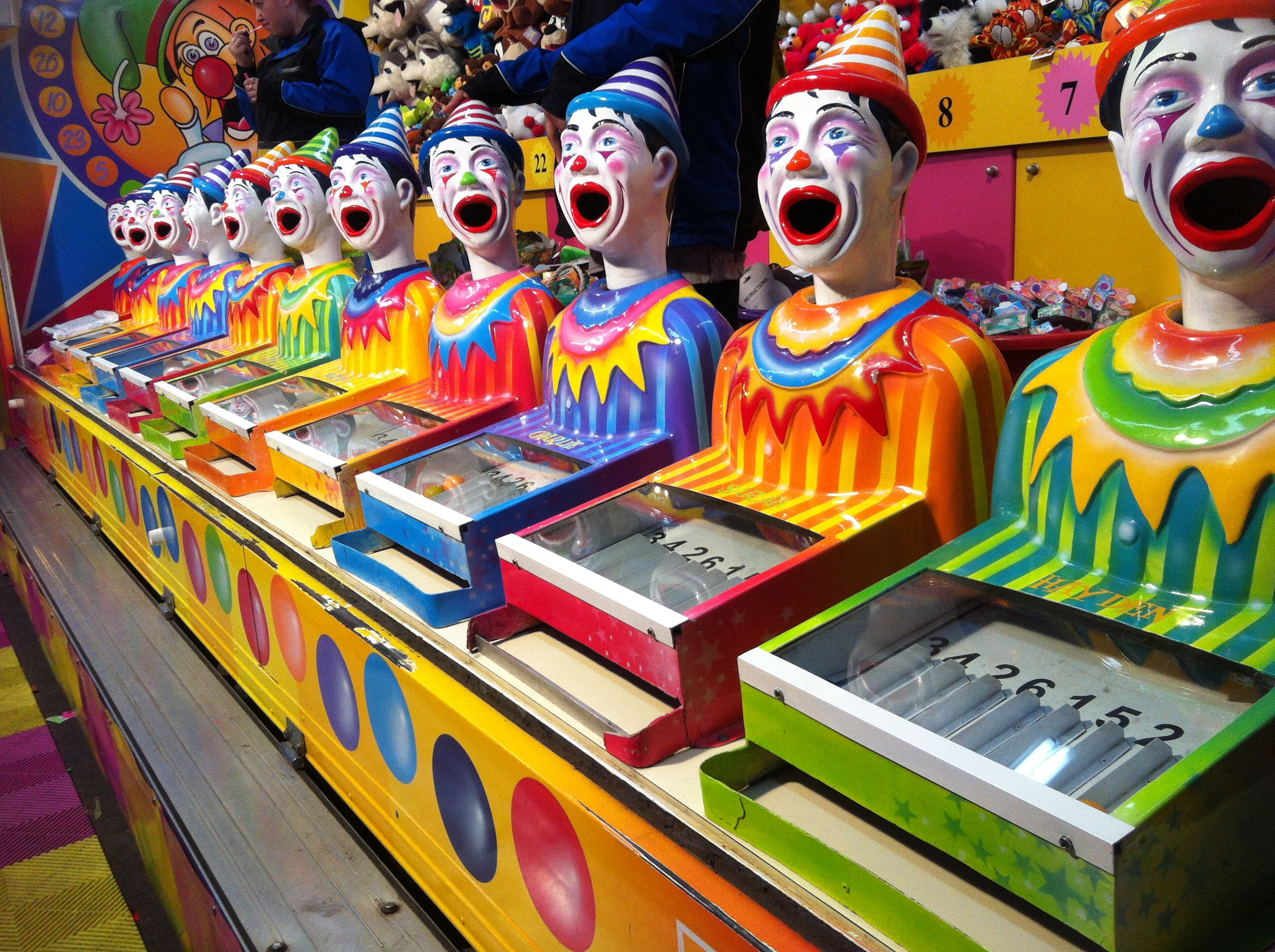 """""""Bring on the Clowns"""" The object of the game is to receive the highest score!  Given 3 pingpong balls, you place the ball s  i  n the clown mouth hoping that the balls fall into the highest number slot to win your prize! Cat love's this game!"""