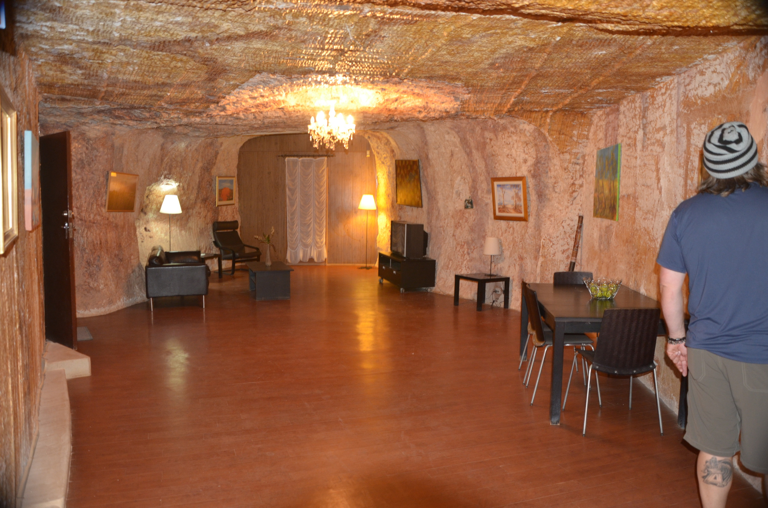 Family room of a locals dug-out. Yes you can have a chandelier underground!
