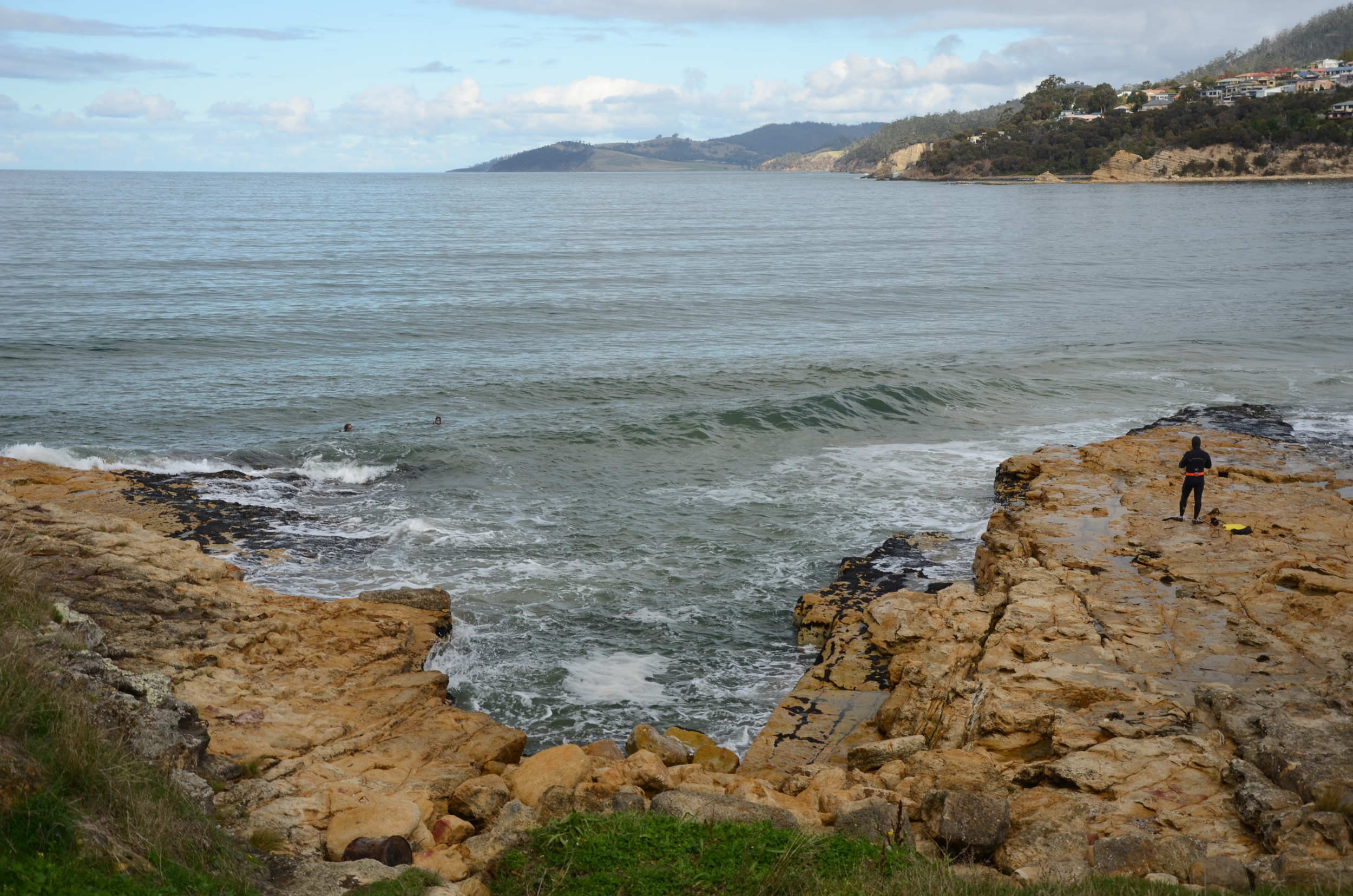 Lunch time entertainment at Blackmans Bay watching 3 guys getting tossed around in the surf spearing fishing!