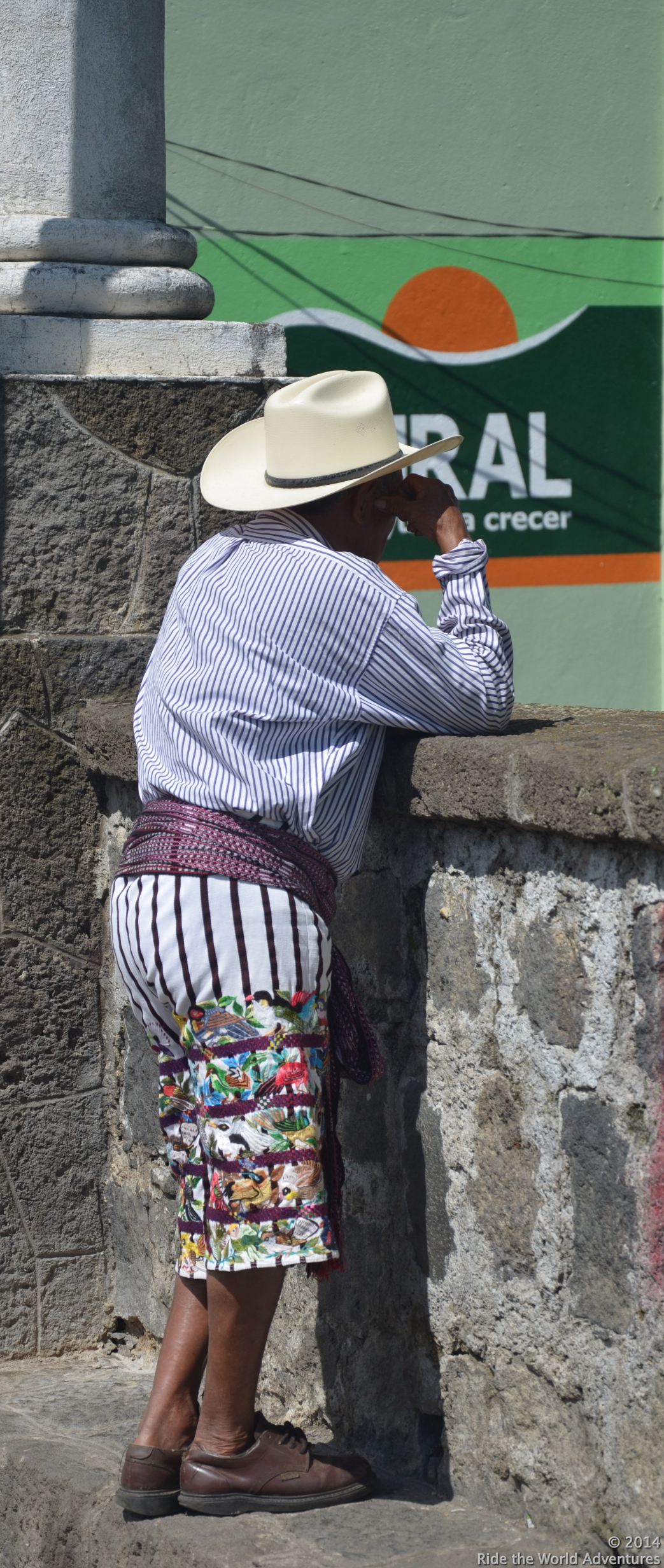 The striped material (top or bottom) is the regional traditional dress for the Santiago area.