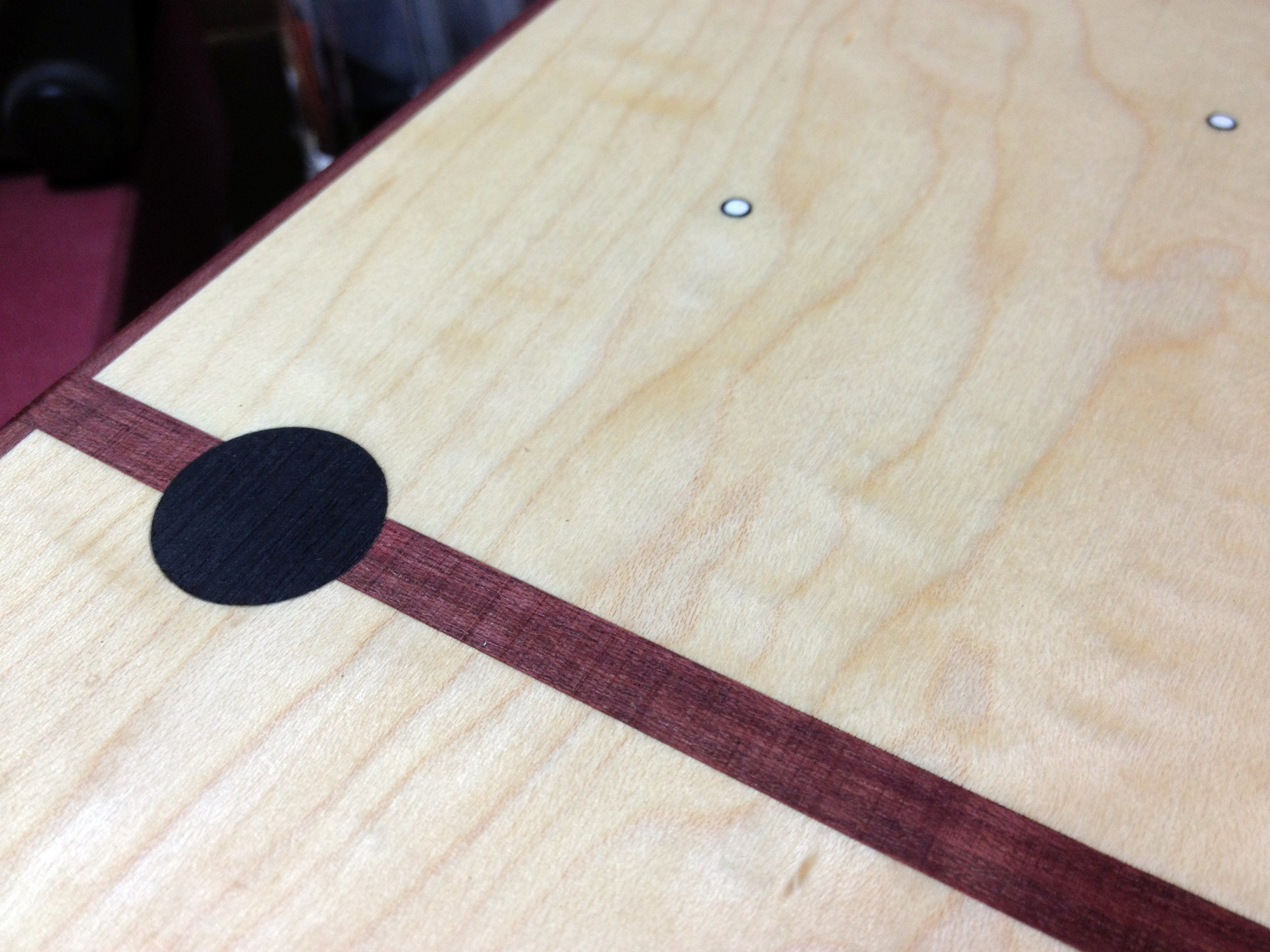 ​Clock #1: Major hour markers are ebony plugs and the off hours are white dots with a black ring.