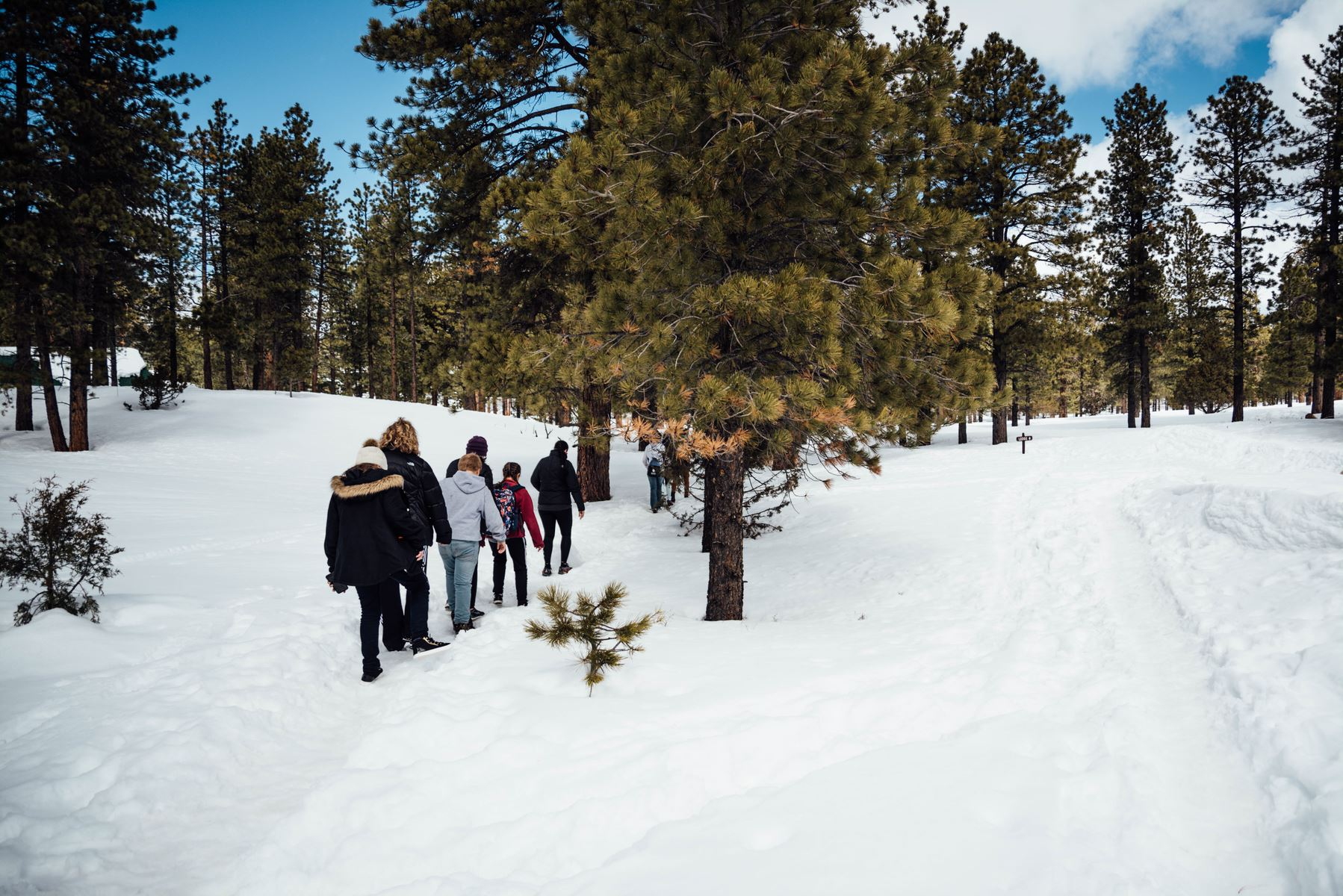 Trekking through the snow at Bryce Canyon