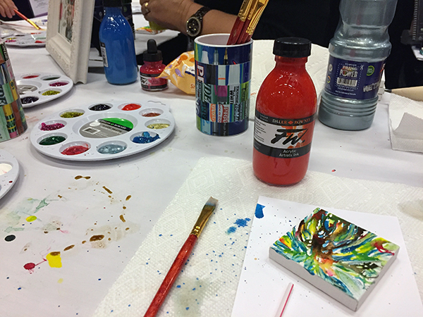 blow liquid ink onto tiny canvas