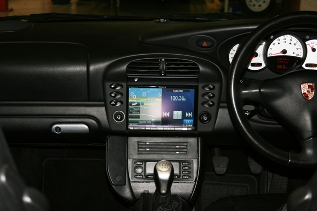 With a some custom fitting, the 8 inch screen looks at home in the Porsche dash.