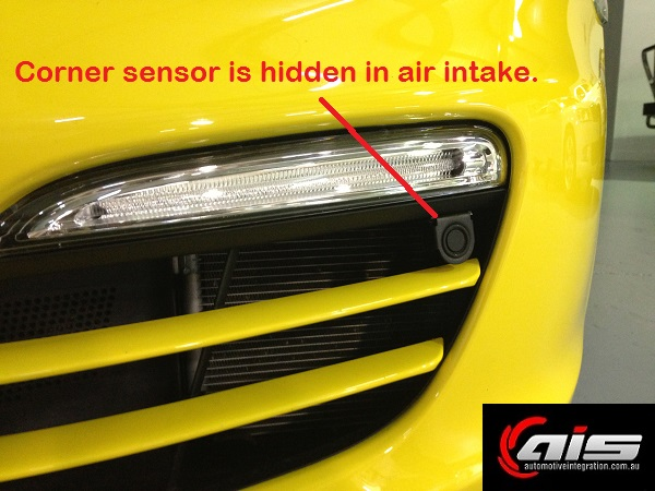 The corner sensors are hidden in the air intakes.