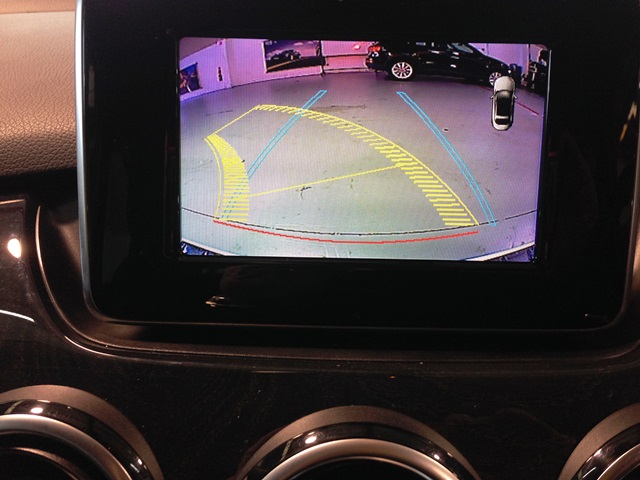 Mercedes Benz active rear camera system with predictive path and on screen parking sensor display.