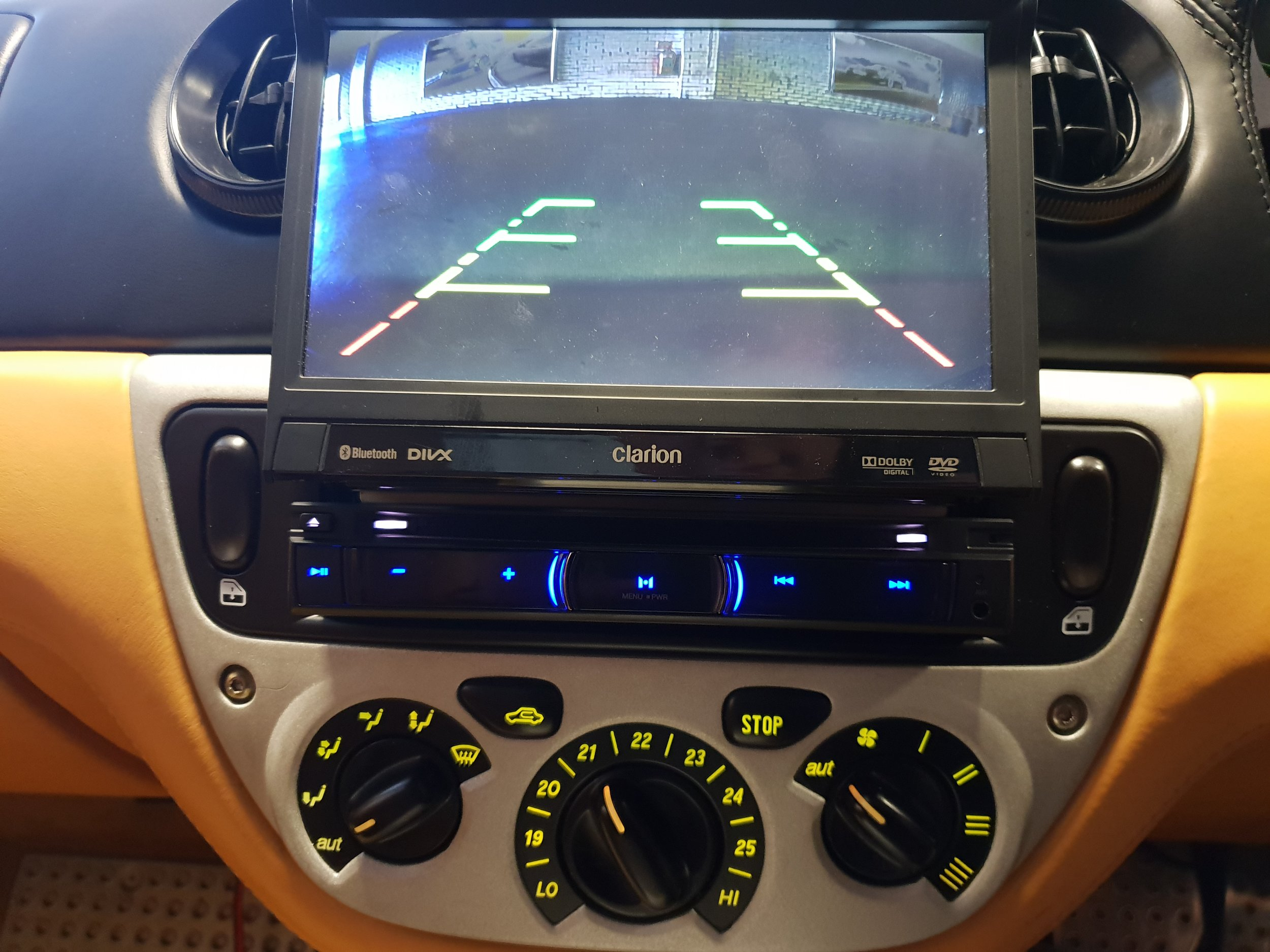 The rear camera displays on the screen automatically when the car is put into reverse