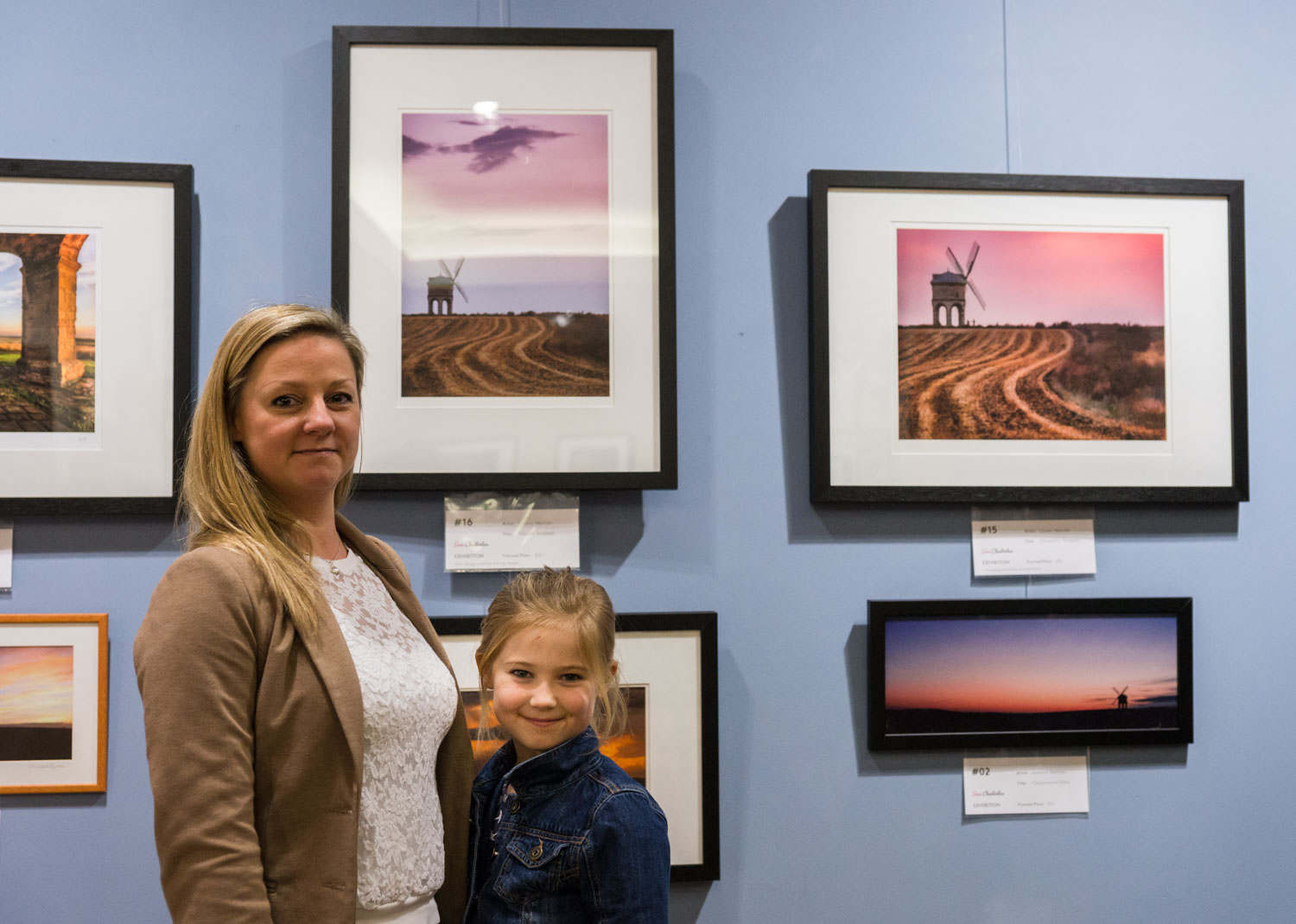 Lynsey Melville proudly standing with her daughter next to her two Chesterton images
