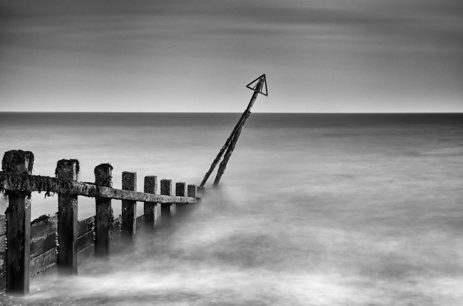 a 10 Stop Neutral Density Filter (Lee Big Stopper) to slow the exposure time and remove detail from the sea