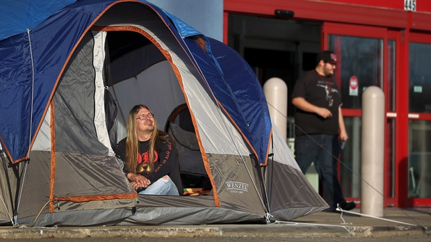 """Tony Avitar has been """"Camping"""" at Best Buyin Cuyahoga Fall, Ohio for four days.  (AP Photo/The Plain Dealer, Scott Shaw)"""