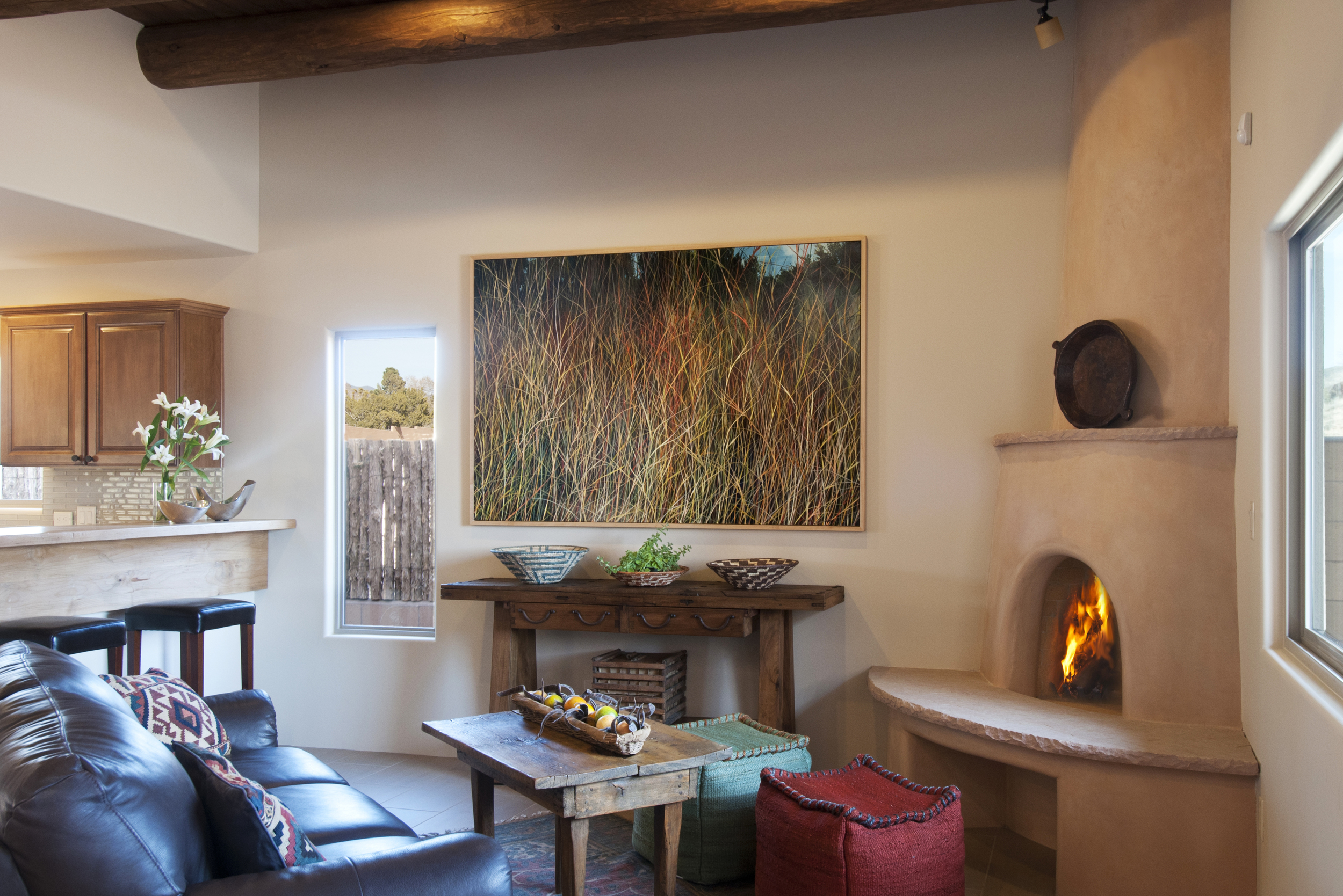 """A Santa Fe Interior described as """"Transitional Pueblo"""" by Jennifer Ashton Interiors, artwork by Charlie Burk, titled: Magic Hour, Photo by Laurie Allegretti"""