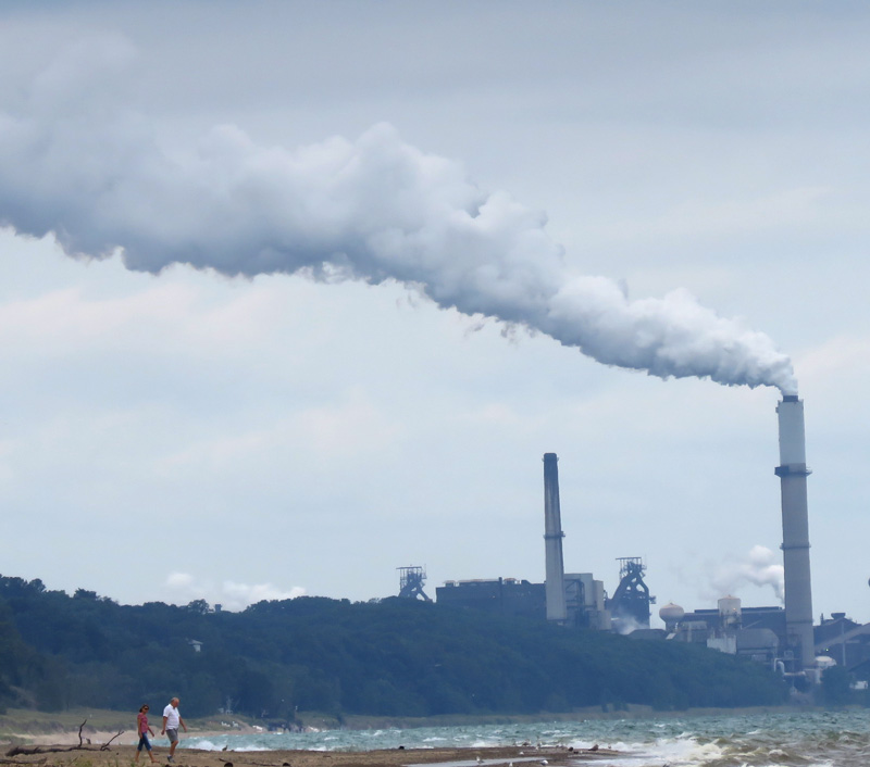 Walking the beach at the Indiana Dunes National Lakeshore brings you face to face with industry. These smokestacks merging with gray clouds is a striking image in a natural preserve.