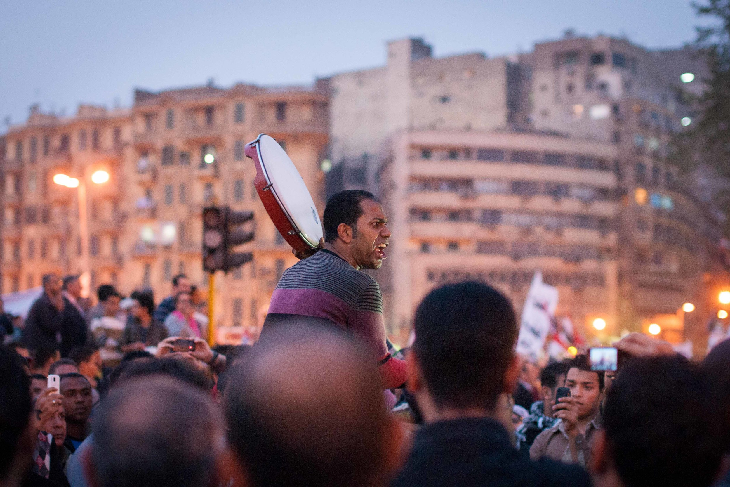 A member of the April 6th Movement (one of the early groups which helped start the Revolution) leads a chant in memory of a member who had been comatose since the beginning of the November 2012 clashes. He passed away three days ago.