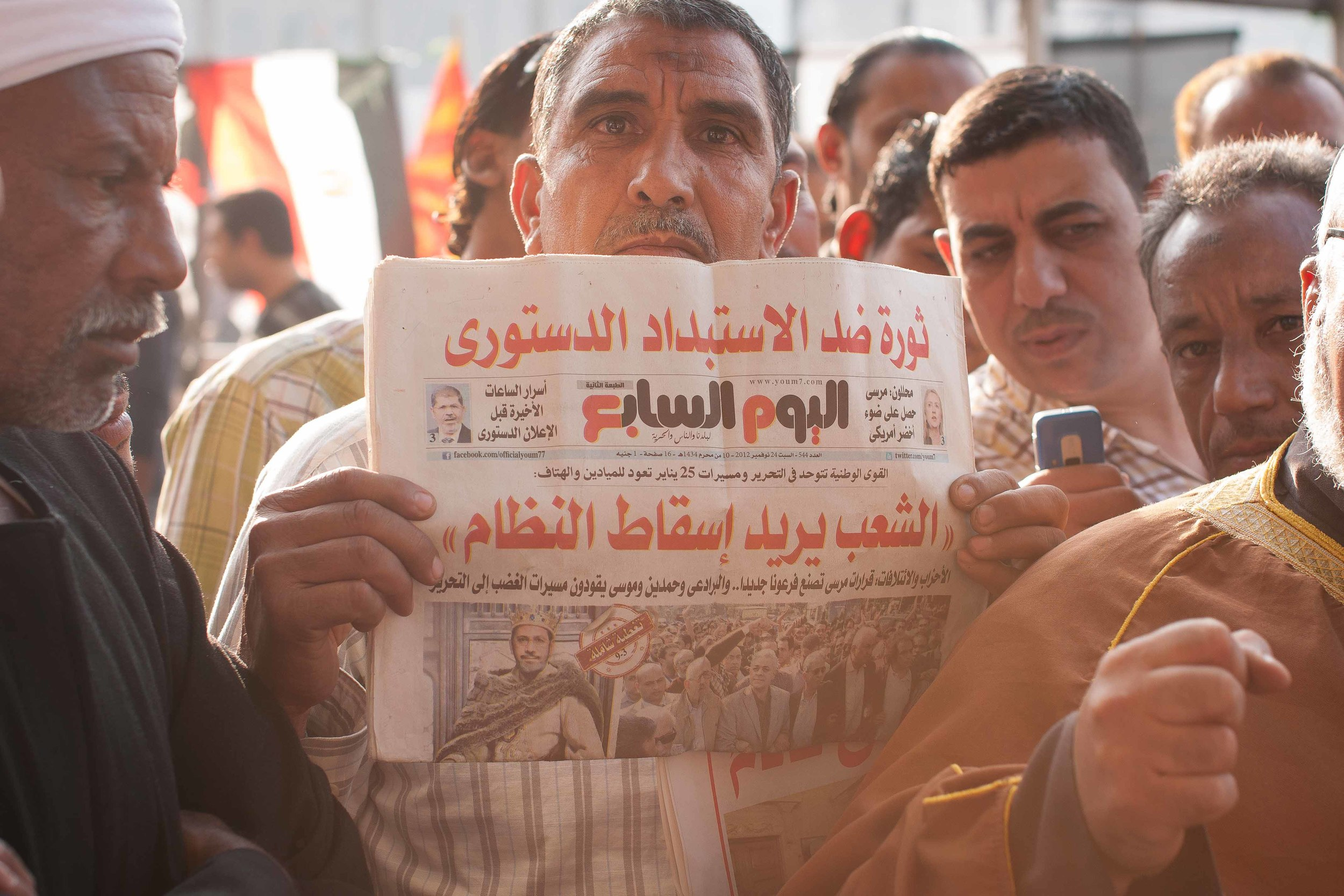 Other than the light, the one thing I love about this picture is the small photo of Morsi wearing a crown. Enough said.