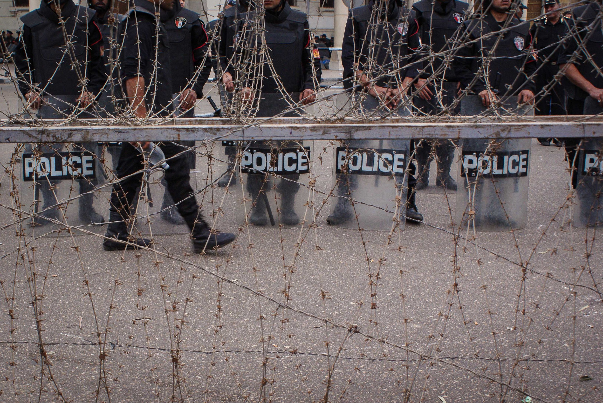 The street outside the palace was heavily guarded- until protestors breached the barbed wire.