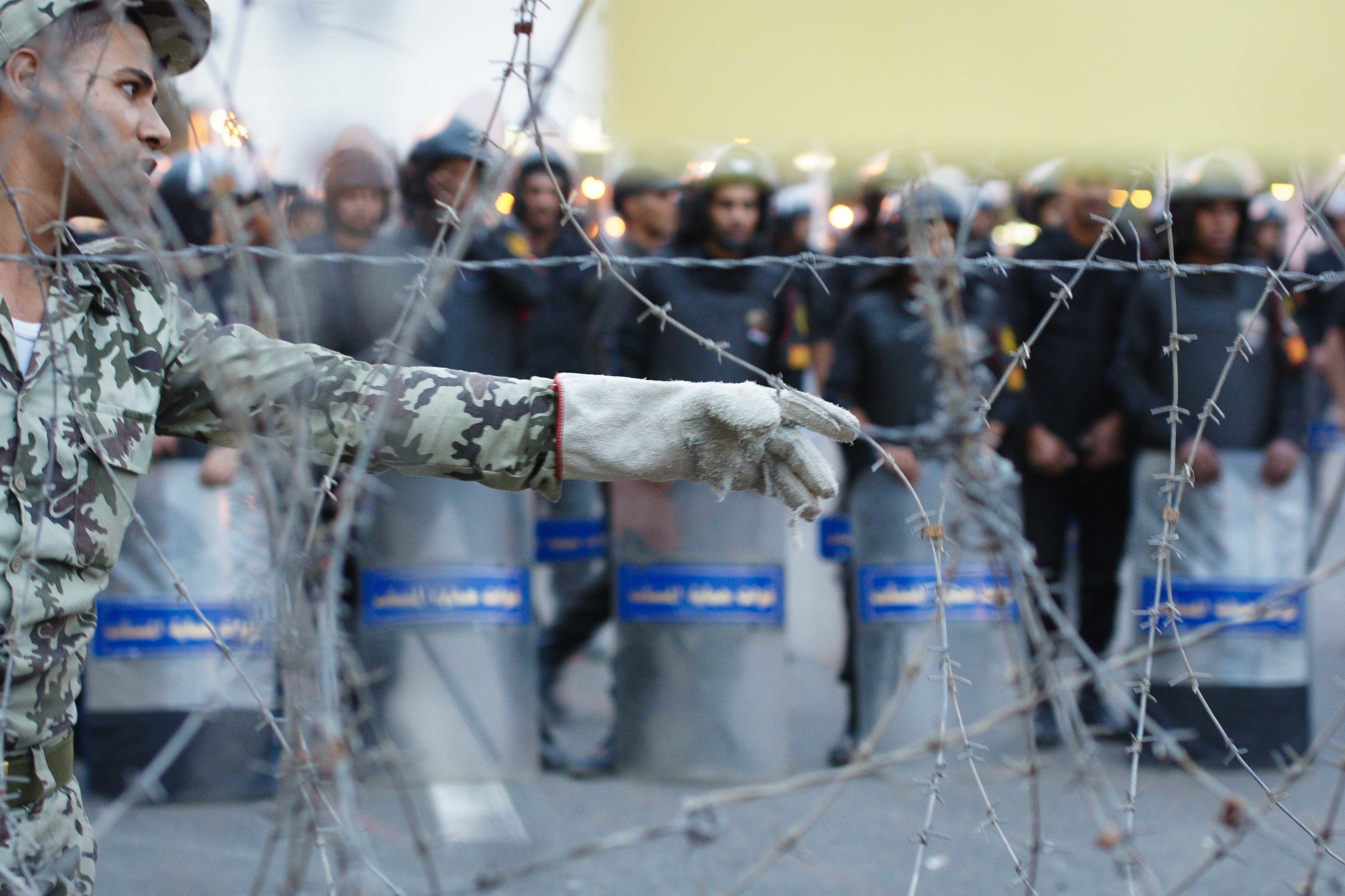 Worried that the crowd kept pushing closer, soldiers ordered the barbed wire barrier be reinforced. Some protestors eventually broke through.