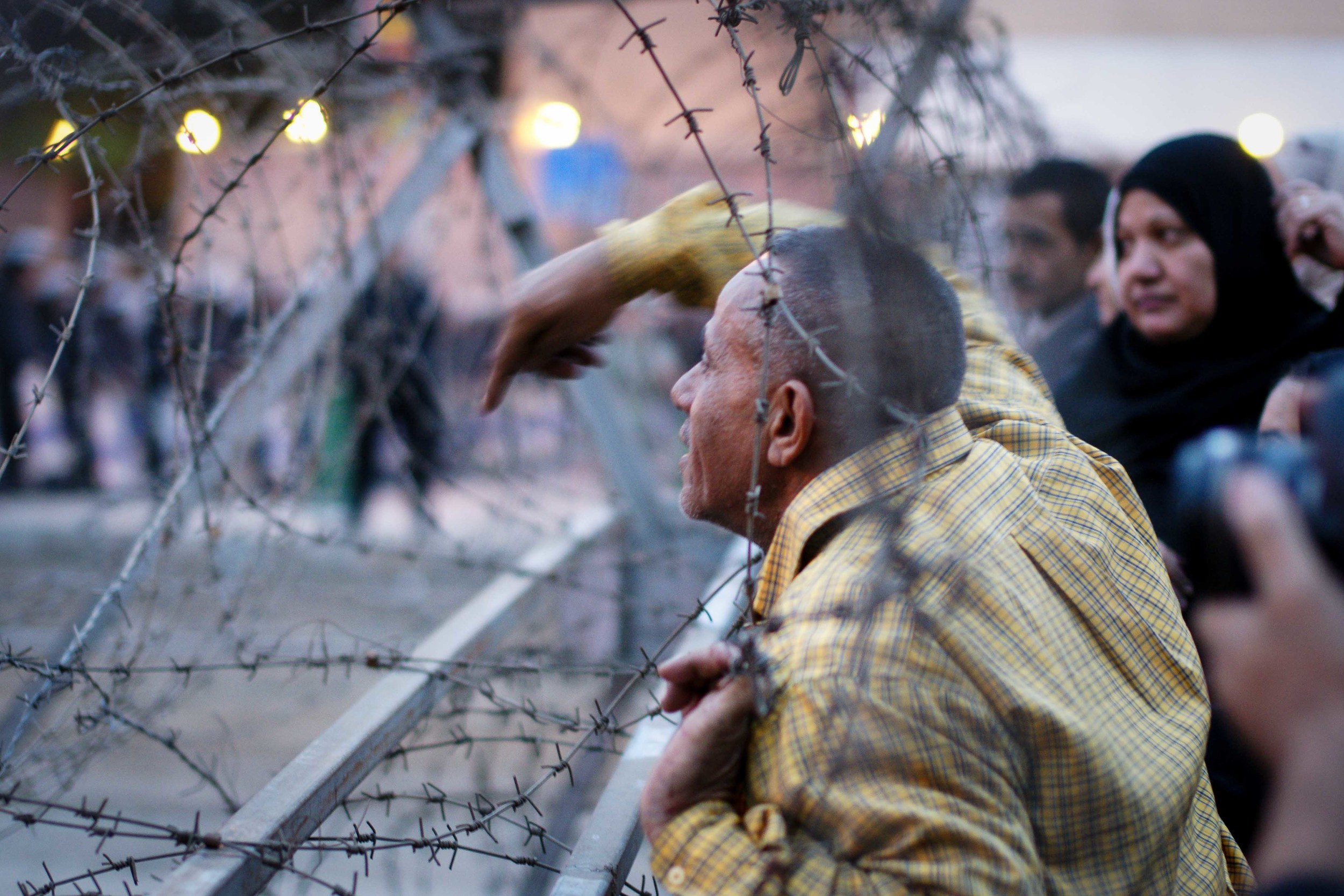 Protestors used the barbed wire as a 'Speaker's Corner' pulpit against the police, and the officers received a tirade of insults.