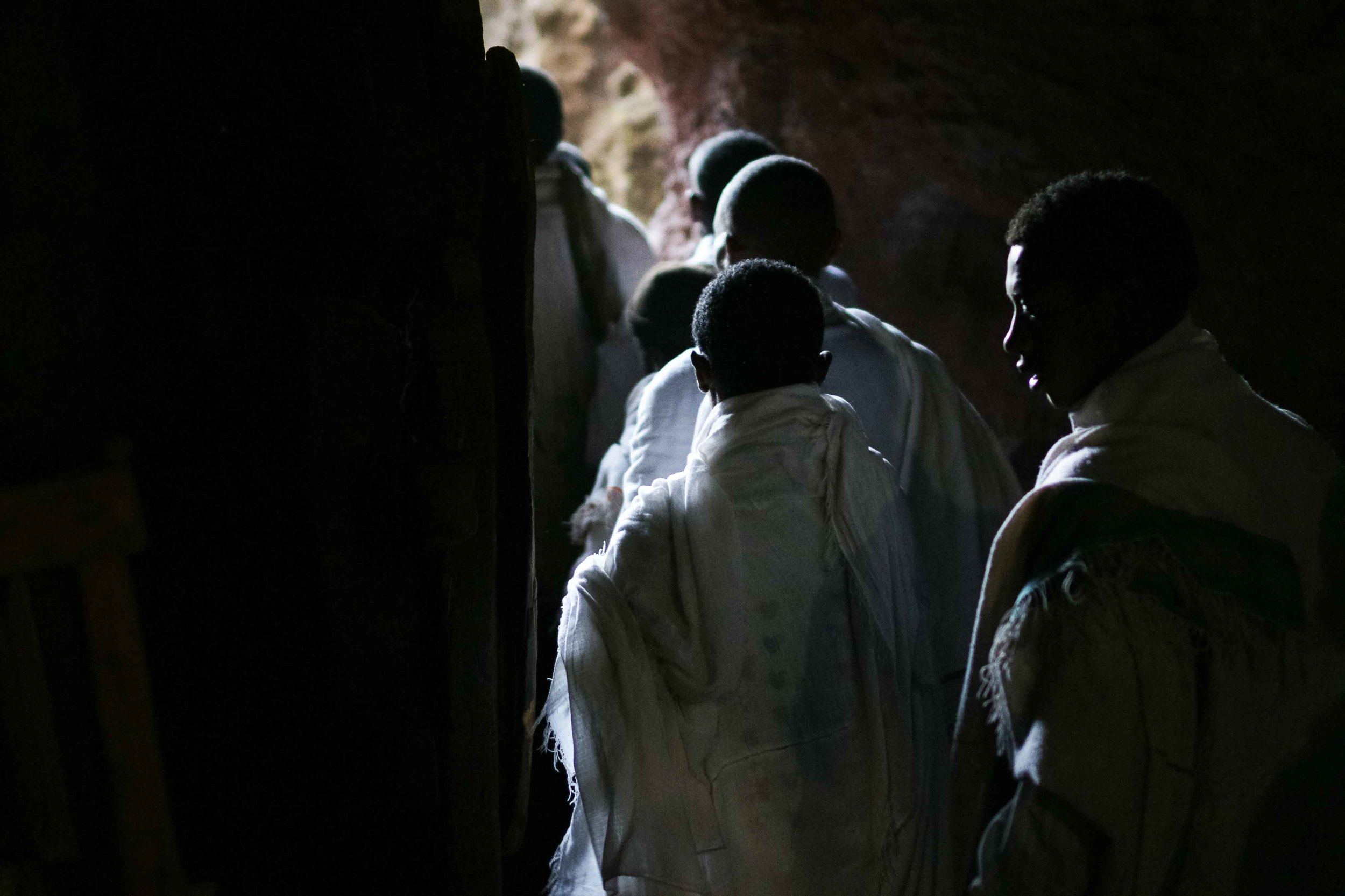 Narrow tunnelsunderneath the churches and within the mountainconnect the churches, and as the number of pilgrims swell dramatically with Christmas approaching, the passages become an increasingly tight traverse. Stories of long treks echo off the cool stone, with one pilgrim telling me of his group's barefoot journey of more than 8 days in order to reach Lalibela. As so many villages are within reach, more than 60,000 pilgrims descend on the churches each Christmas.