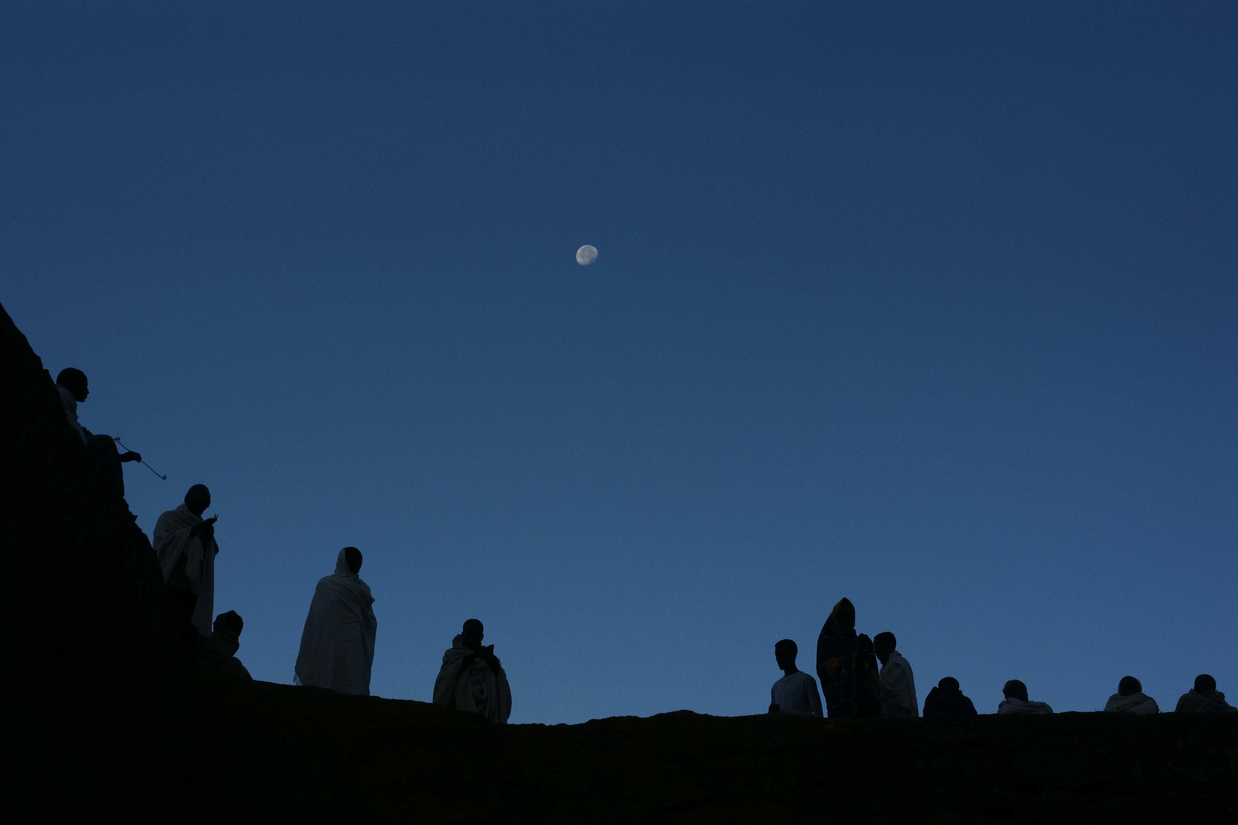 Pilgrims gather early in the morning to attend prayers at Bet Giyorgis.