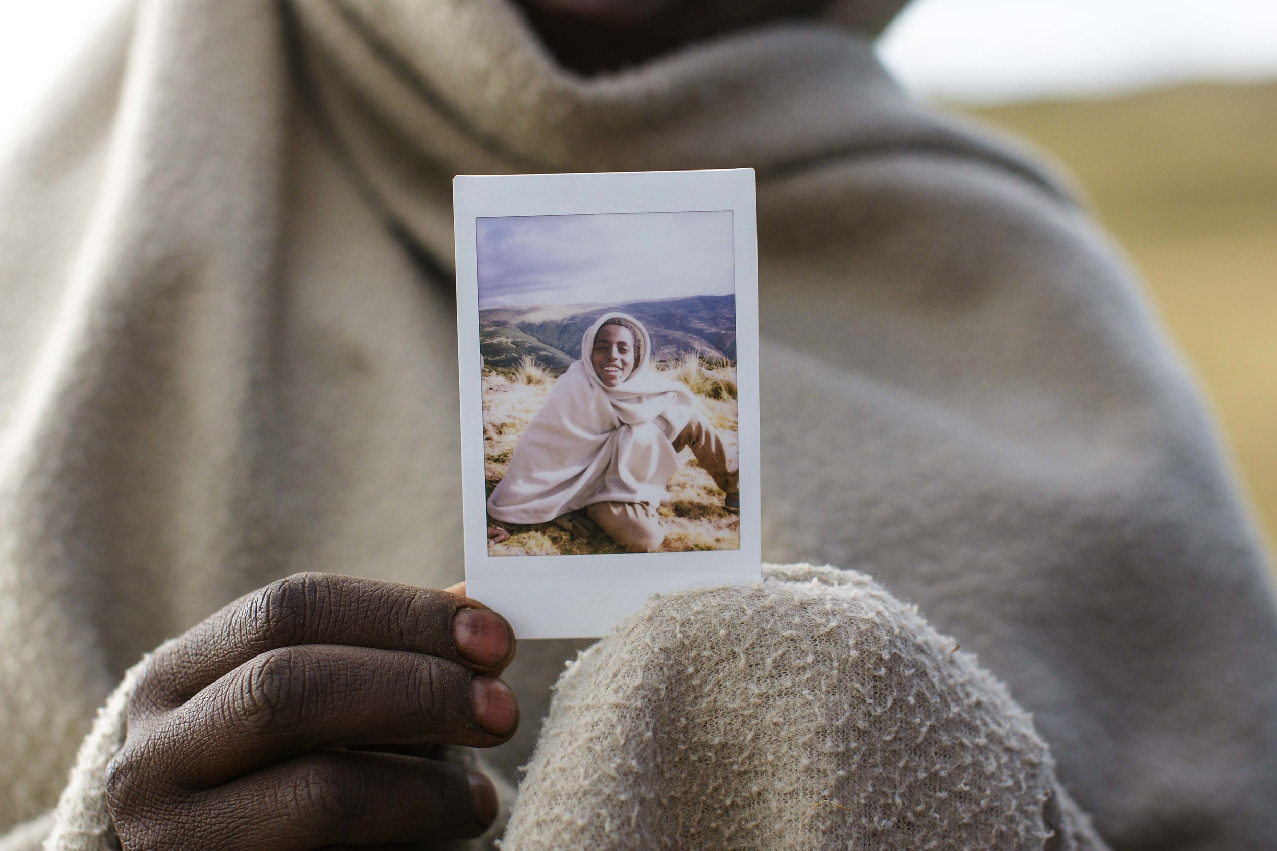 The picture of the boy in the Simien Mountains. After we talked and he got this picture, we both left happy.