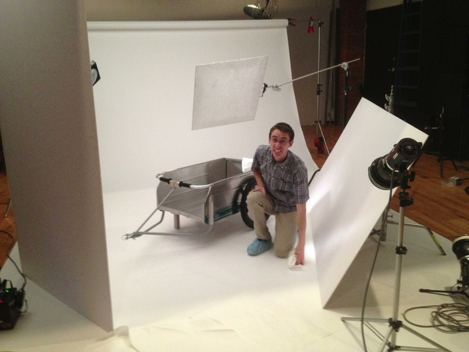 Studio Assistant Chris Thompson prepping the product and taking a mighty fine portrait.