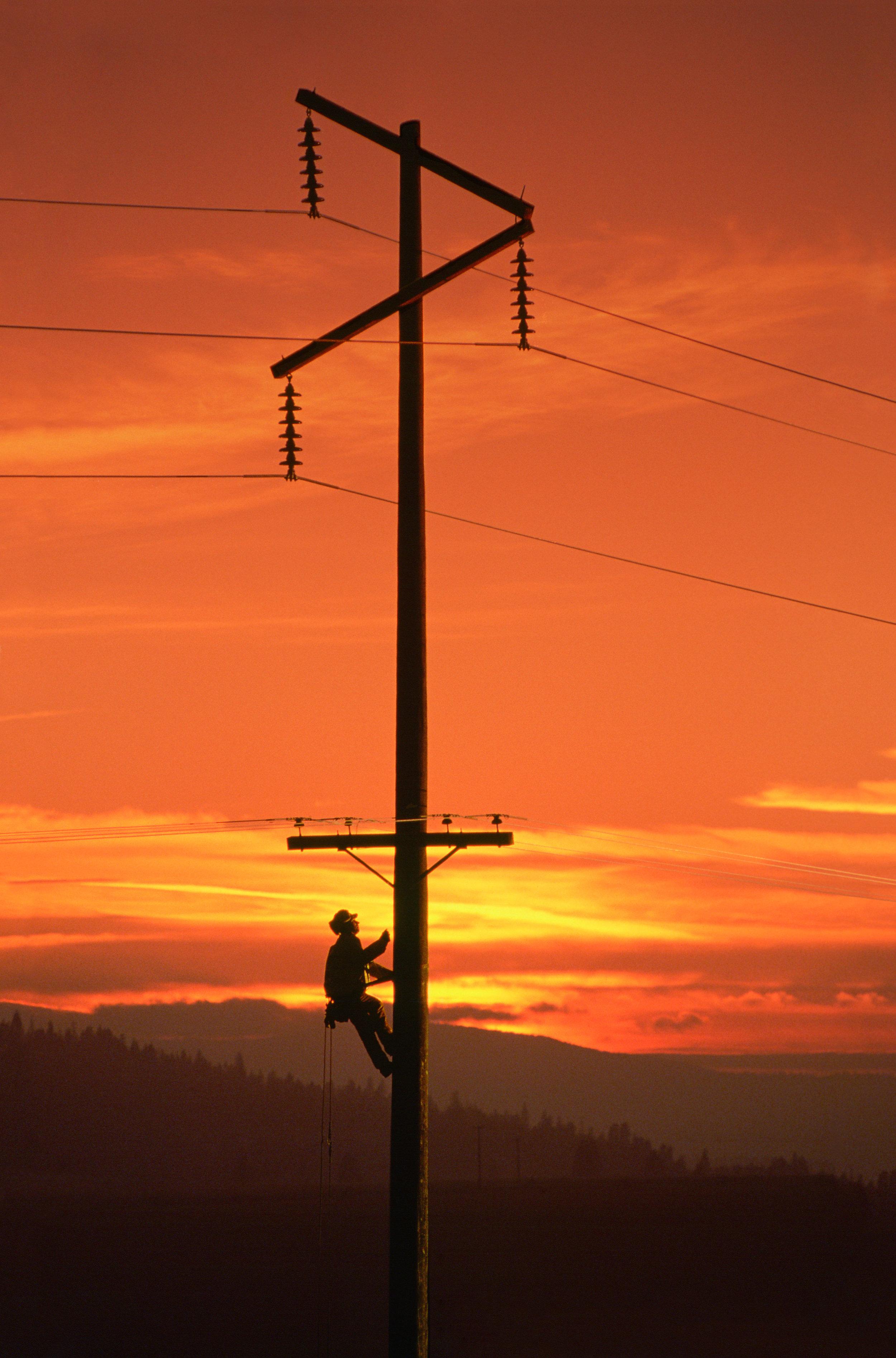 lineman working sunset
