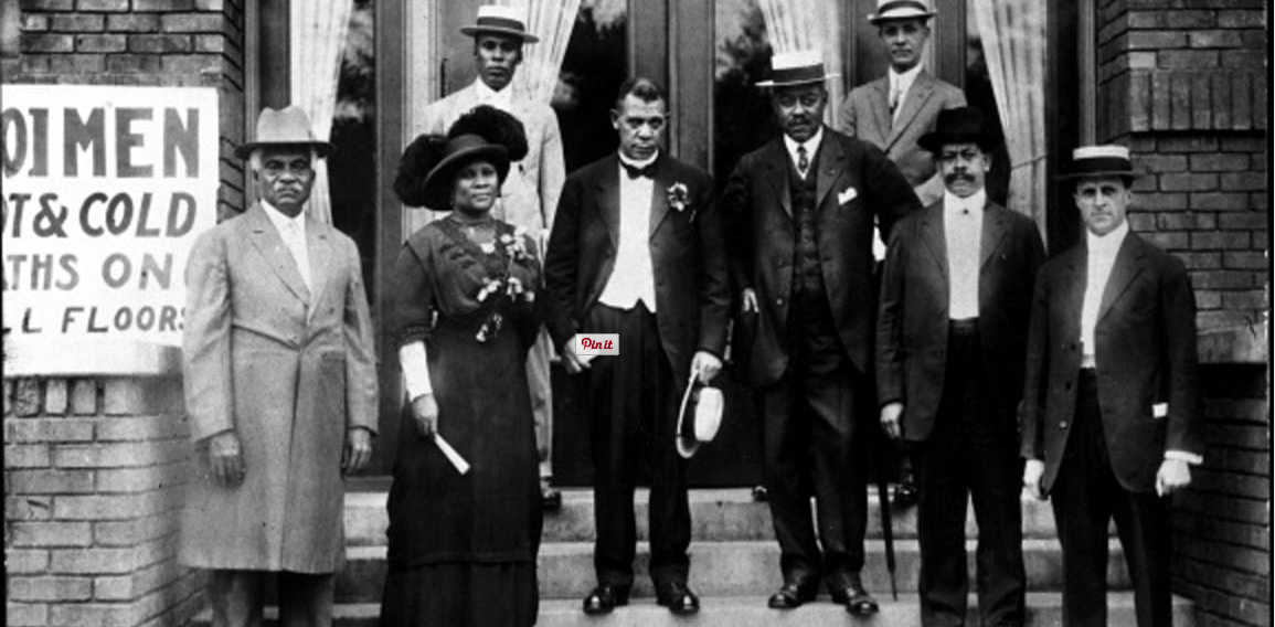 Photo of attorney Freeman B. Ransom, standing in the back to the left, along with Madame C.J. Walker, Booker T. Washington, and others at the dedication of the Senate Avenue YMCA on July 13, 1913. Ransom served as legal counsel for the Walker Company. Photo credit: Indiana Historical Society.