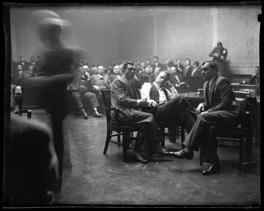 John Dillinger during a court hearing in Crown Point, Indiana (1934). Photo via Chicago Tribune.