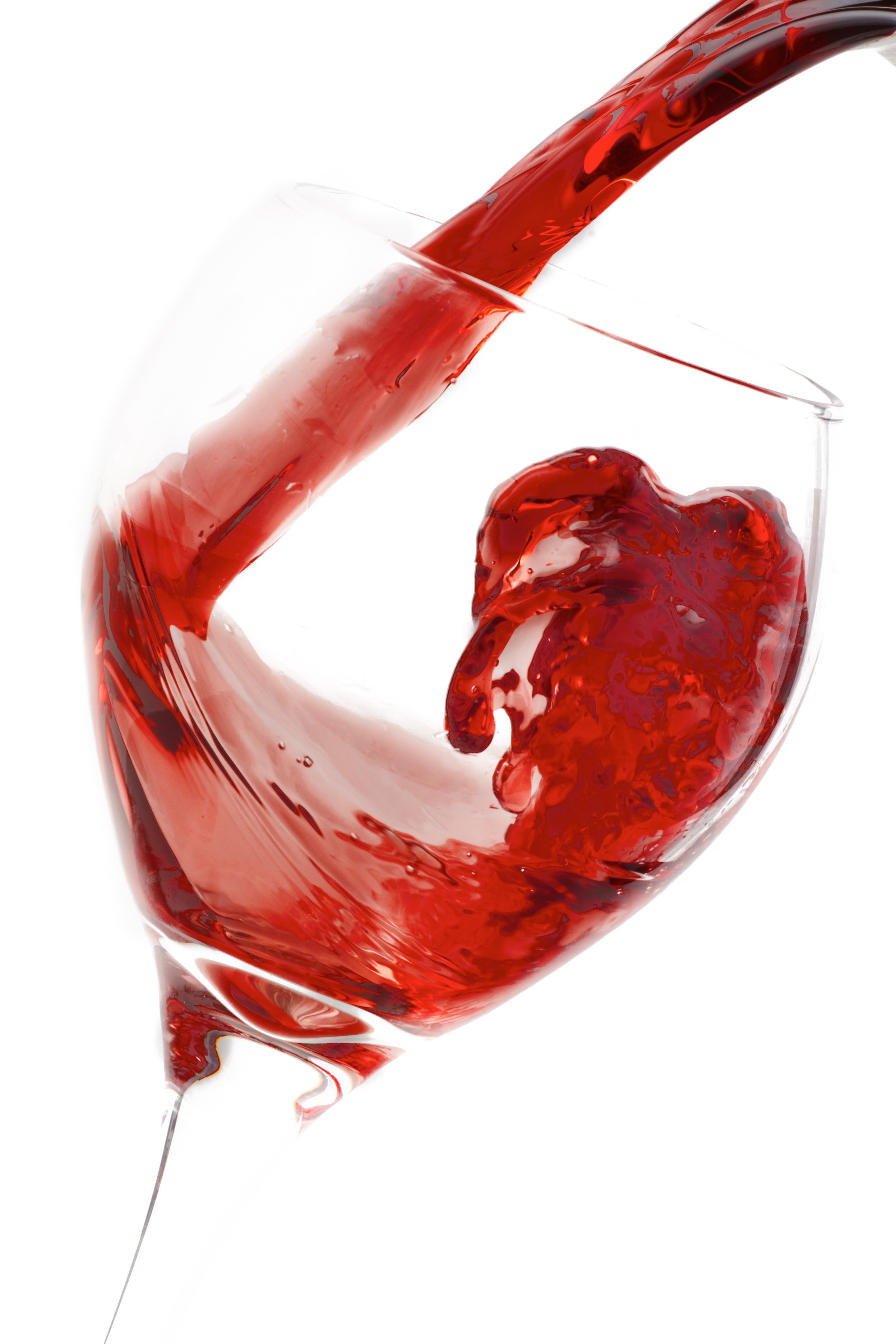 Professional commercial photograph of red wine being served on a cup on a white background.
