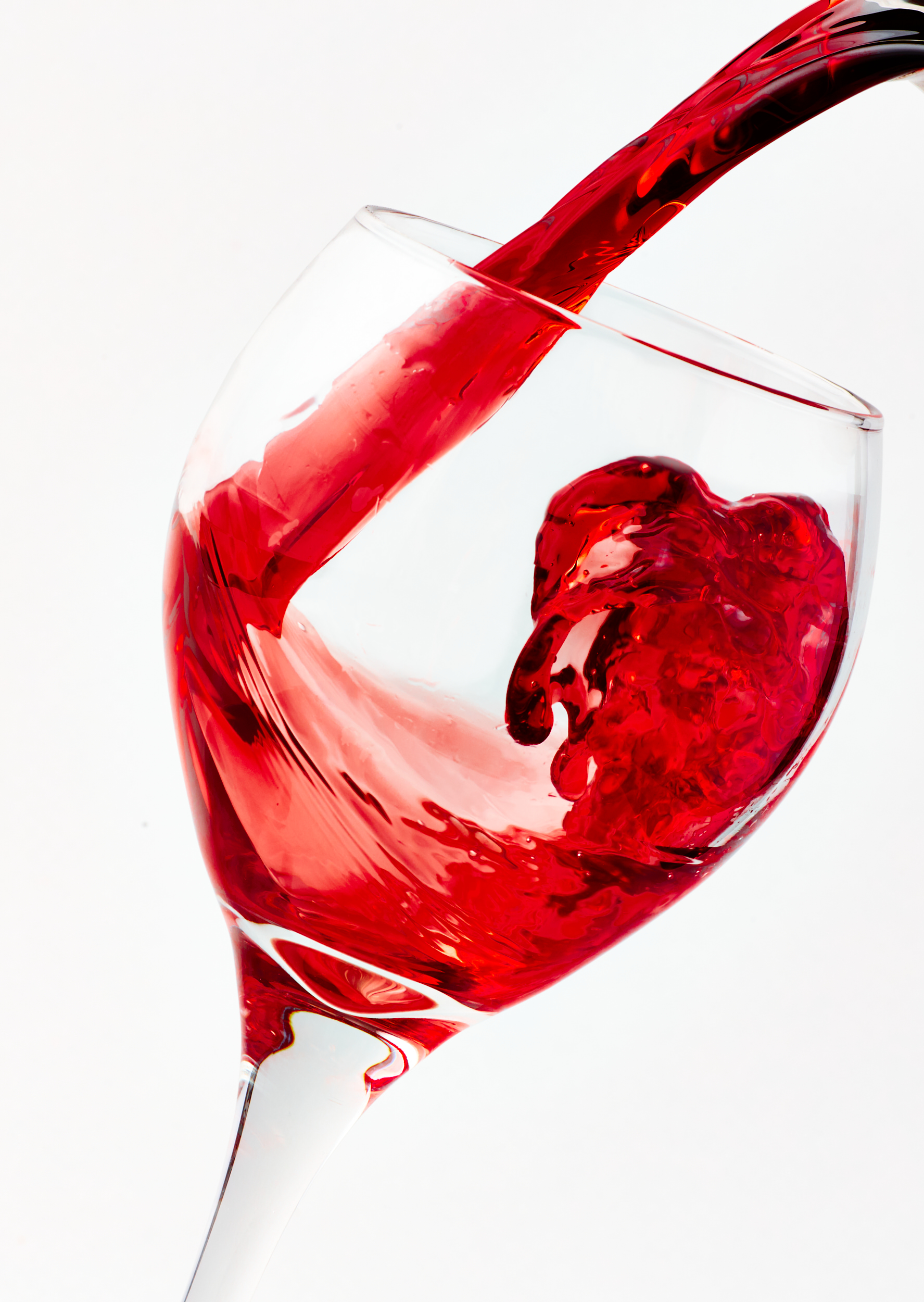 Professional picture of red wine pouring into a glass.